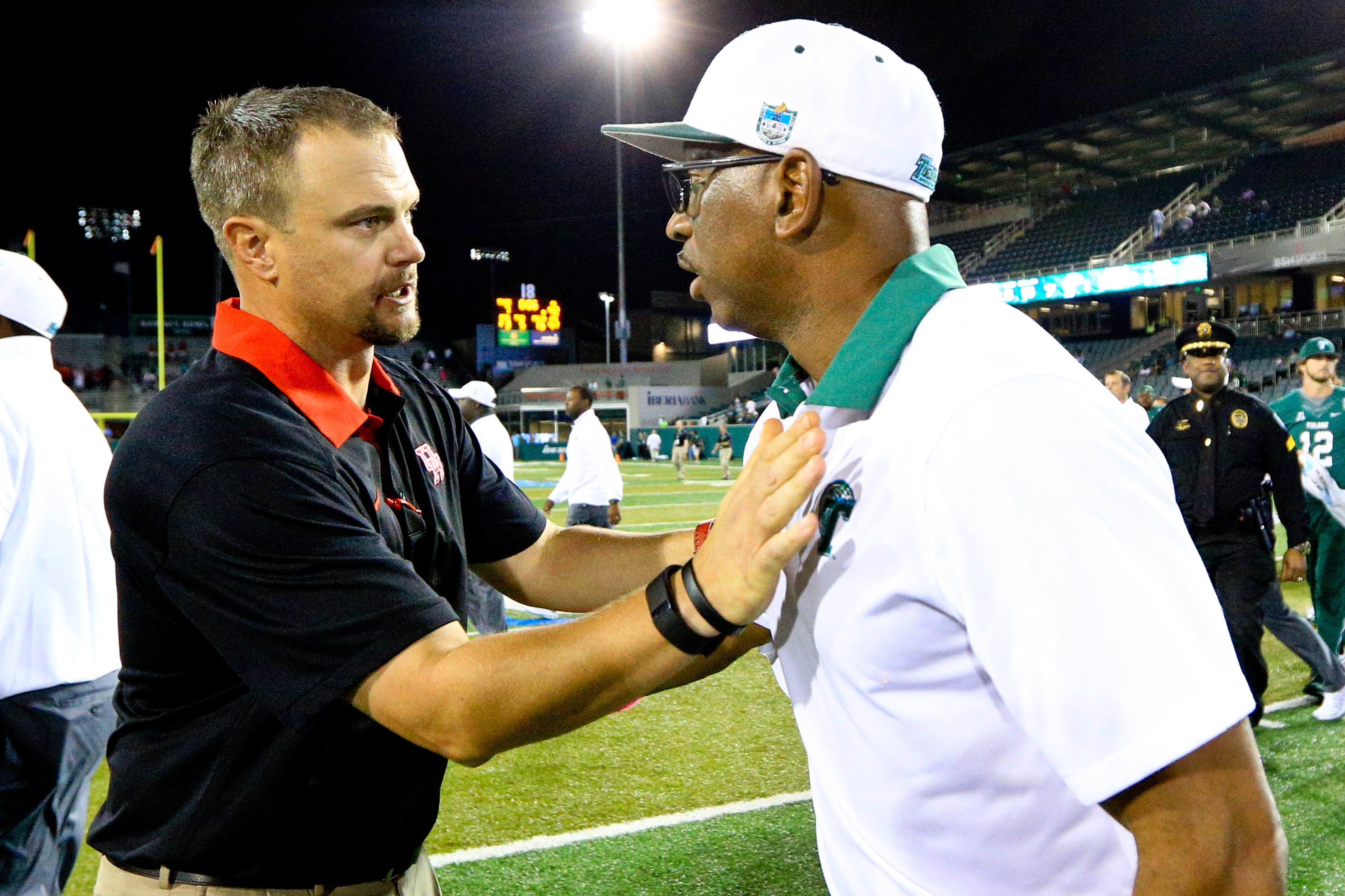 Tom Herman (left) is making $1.45 million this year, but has a buyout of $2.25 million.