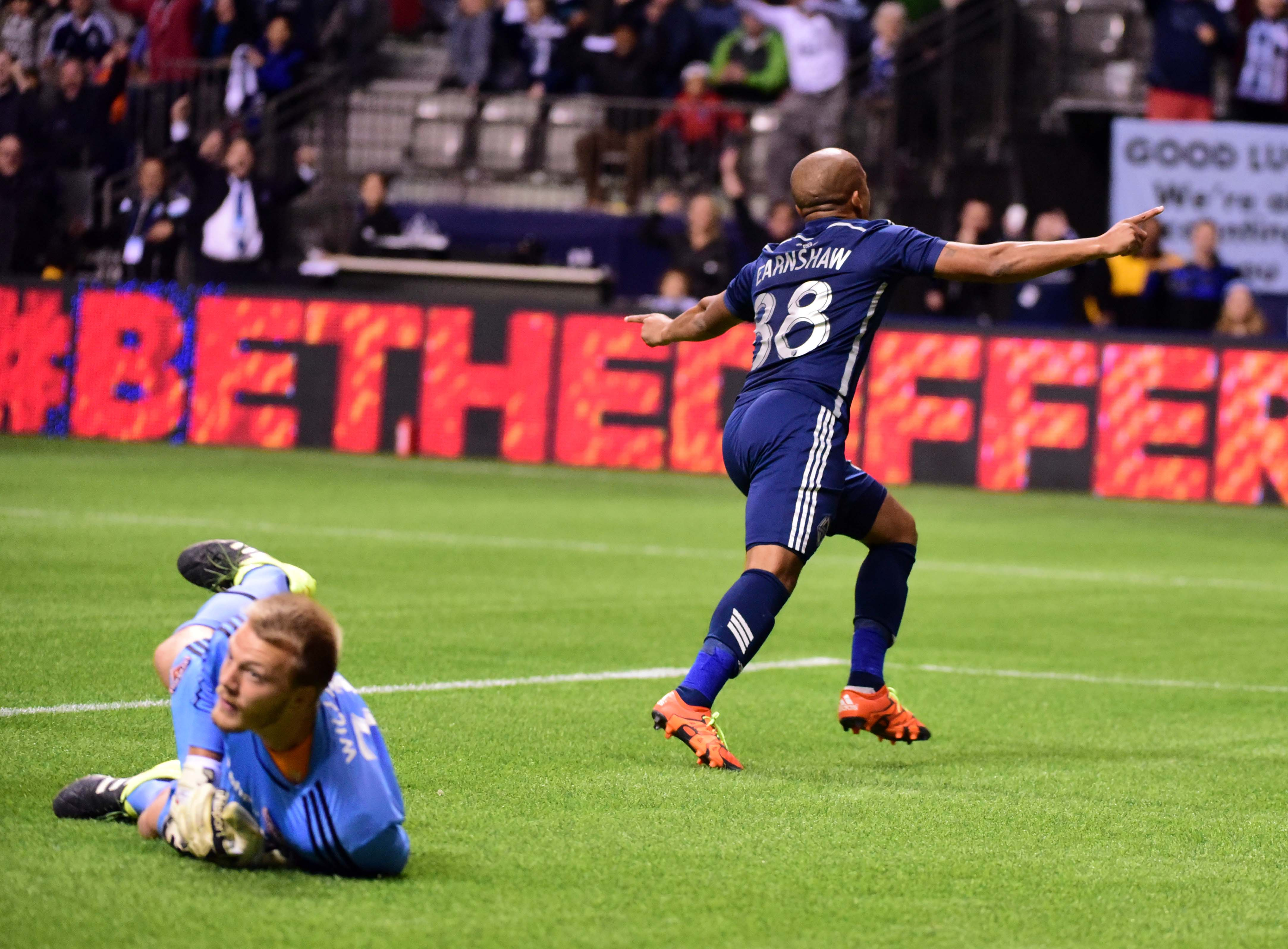 Robert Earnshaw (right) split the defense and headed in the final goal of the Whitecaps' 3-0 domination of the Dynamo.
