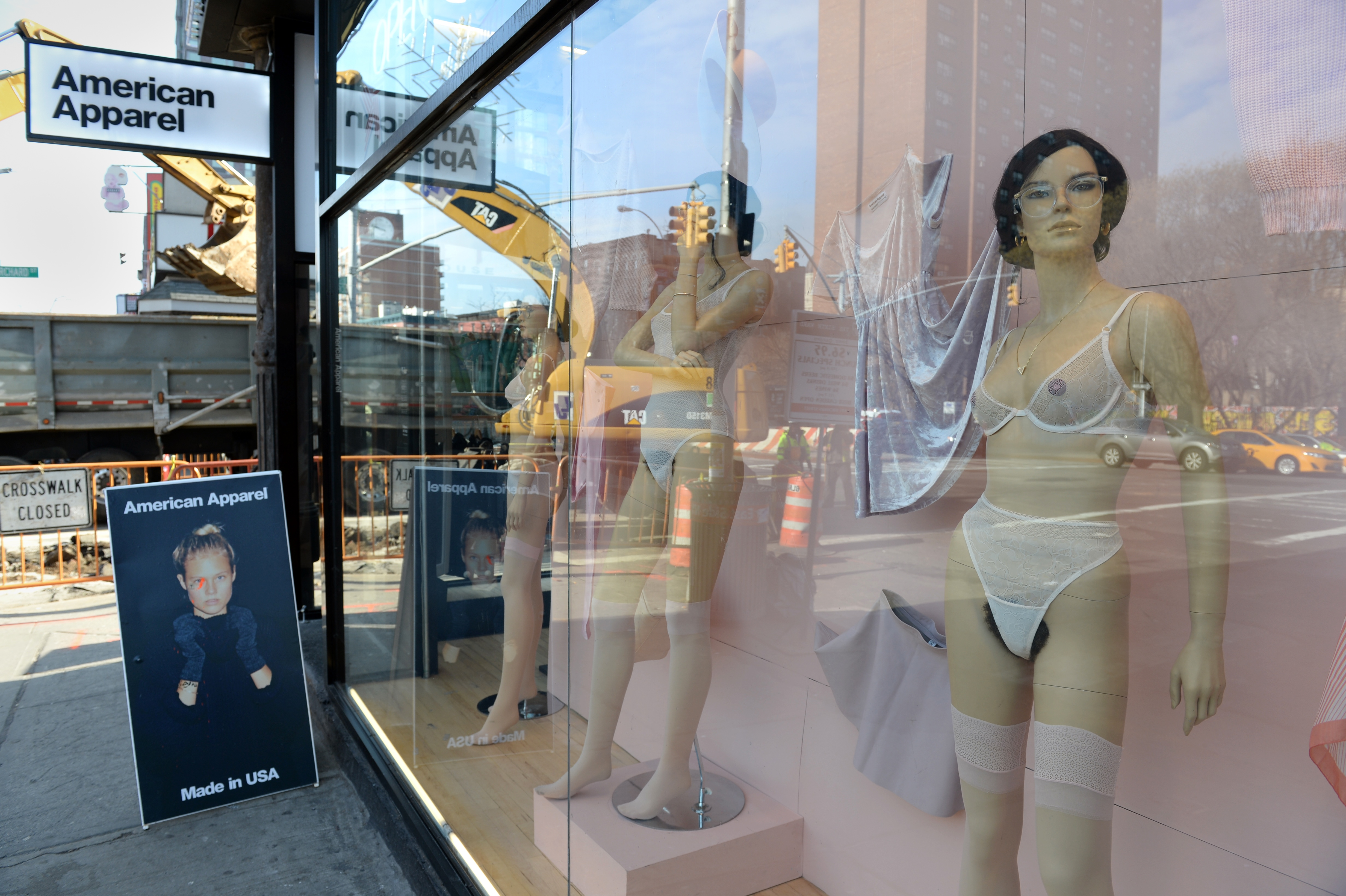 Say farewell to American Apparel's out-there window displays.