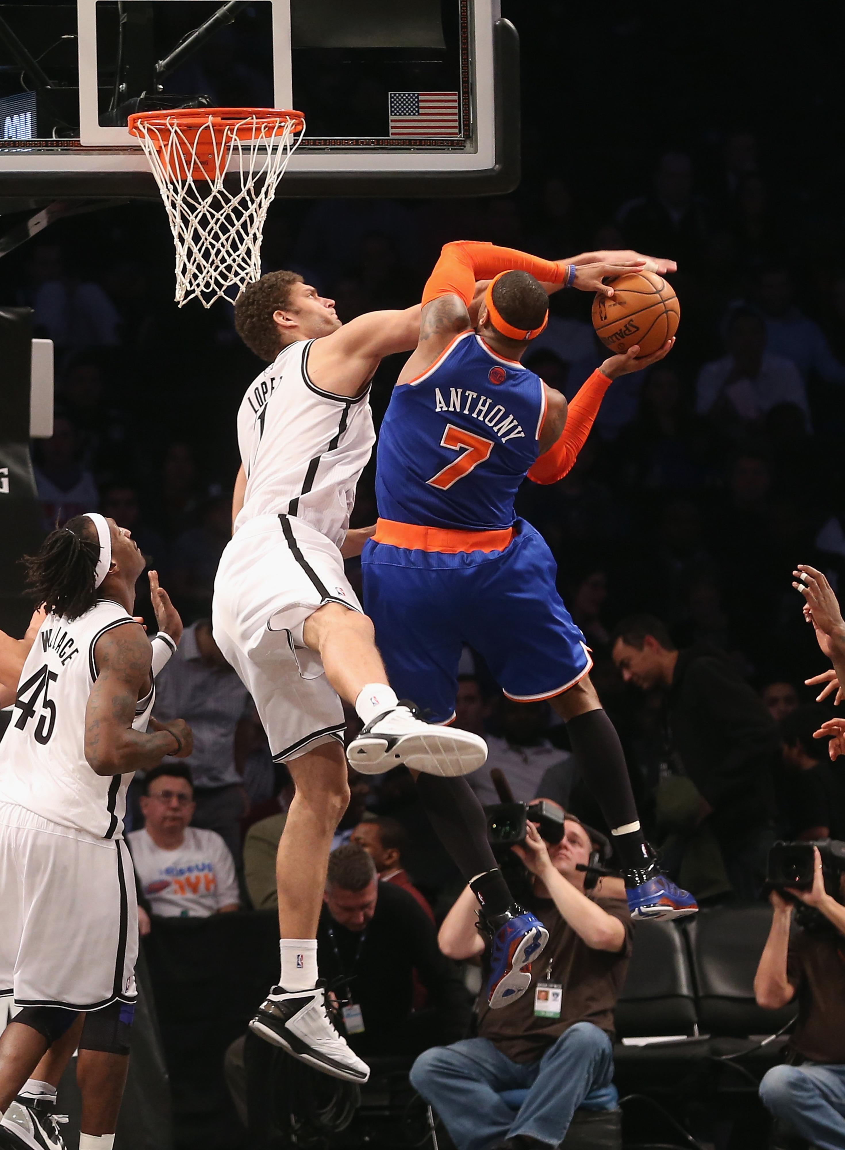 Brook Lopez blocks a shot by Carmelo Anthony
