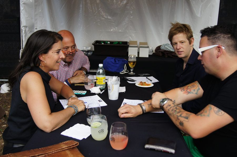 Britt Daniel, back right, with fellow judges Andrew Zimmern, Christina Grdovic, and Graham Elliot at Austin Food and Wine Festival 2014.