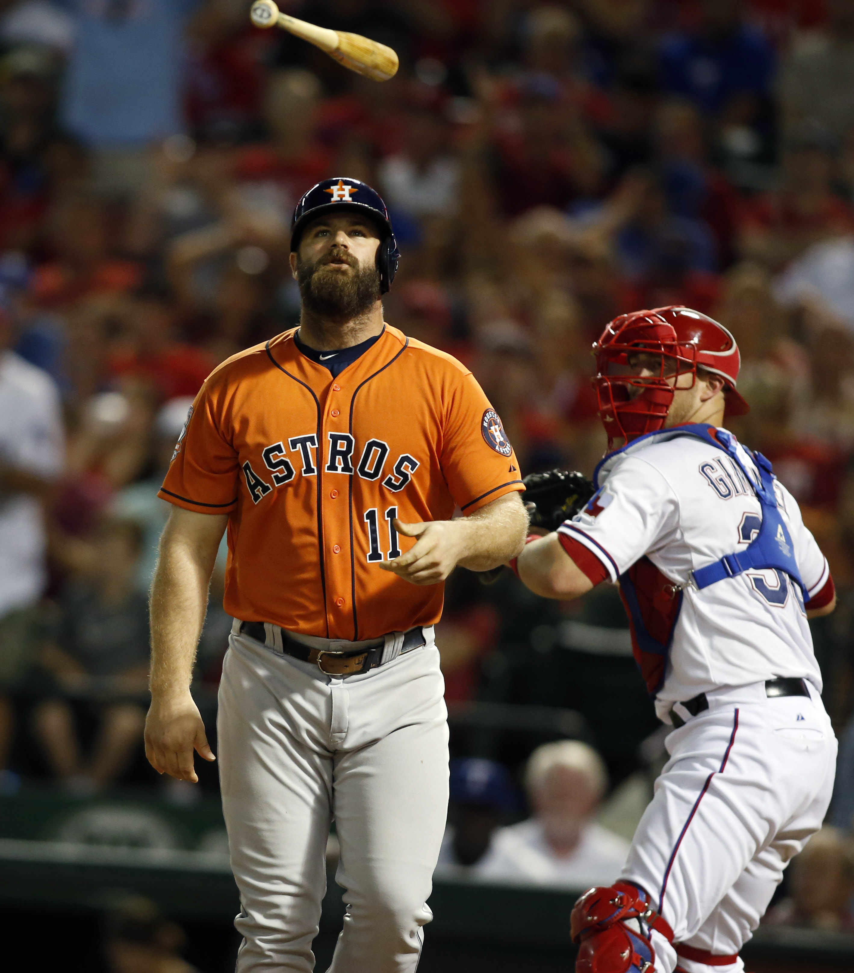 Evan Gattis reacts to striking out against the Rangers
