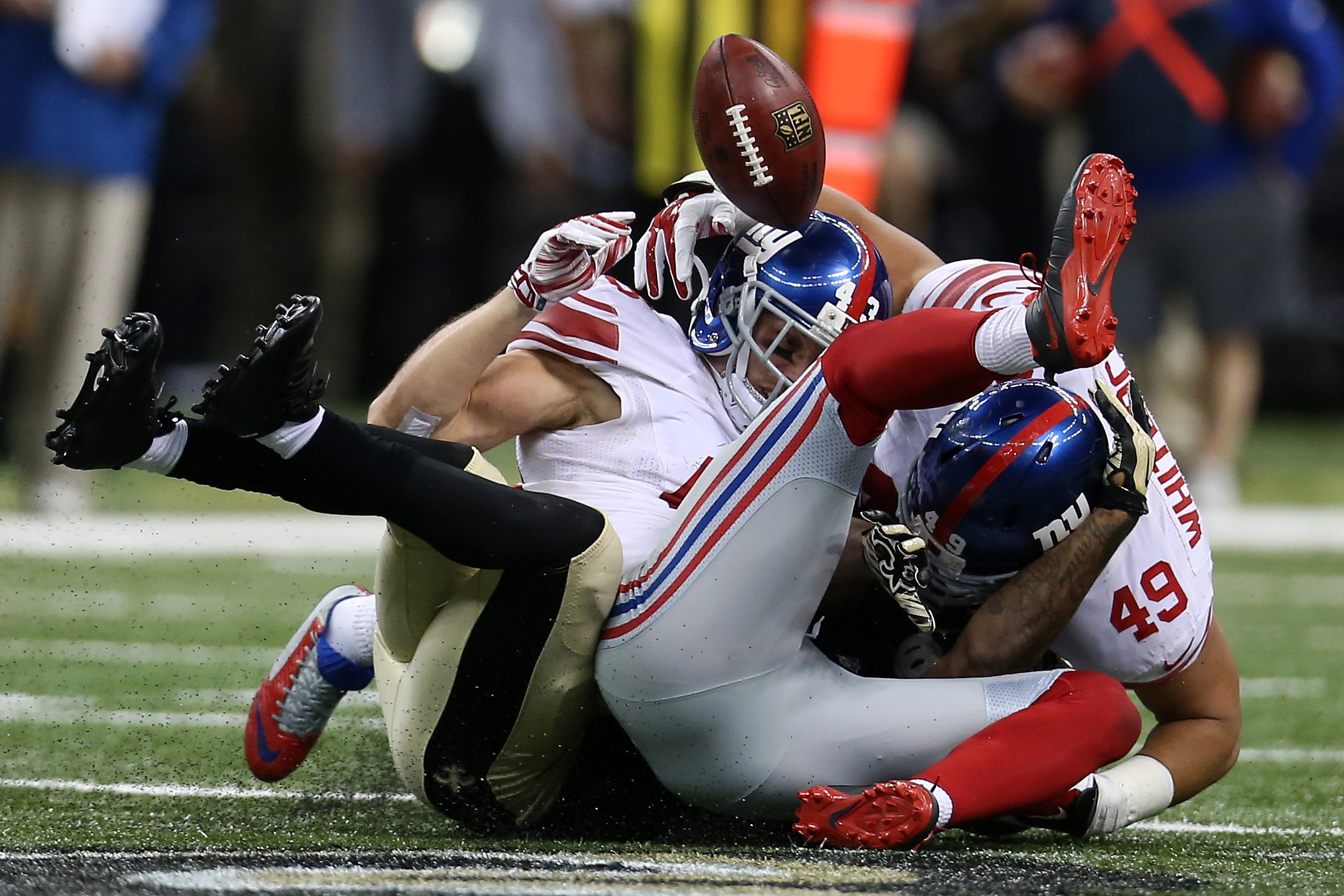 Marcus Murphy fumbles the games final punt return, leading to a game-changing face mask penalty on Giants' punter Brad Wing