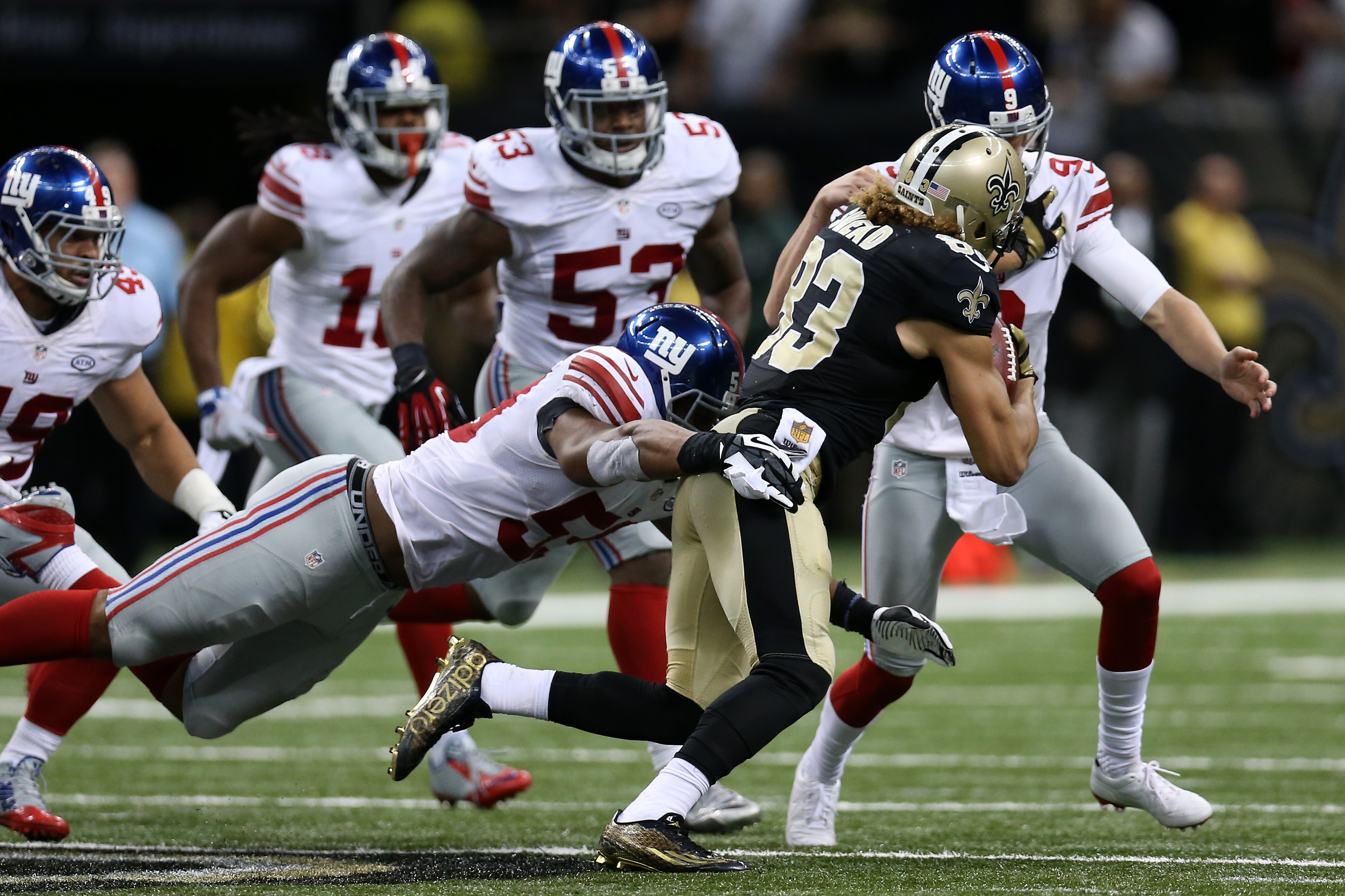Brad Wing of the Giants drew a game-deciding face mask penalty on this play