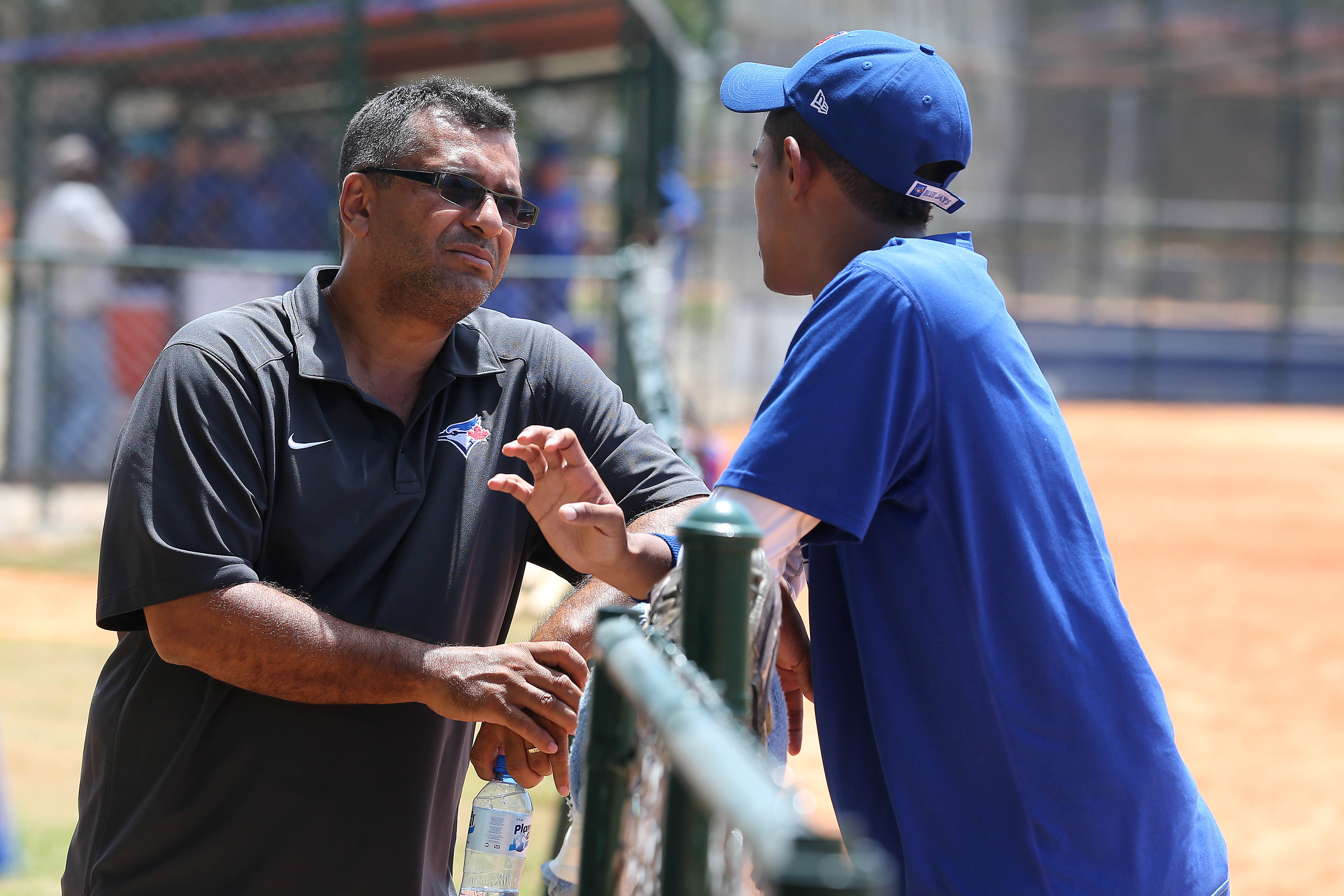 Ismael Cruz, seen here at left at the Blue Jays' academy in the Dominican Republic, is reportedly headed to Los Angeles.