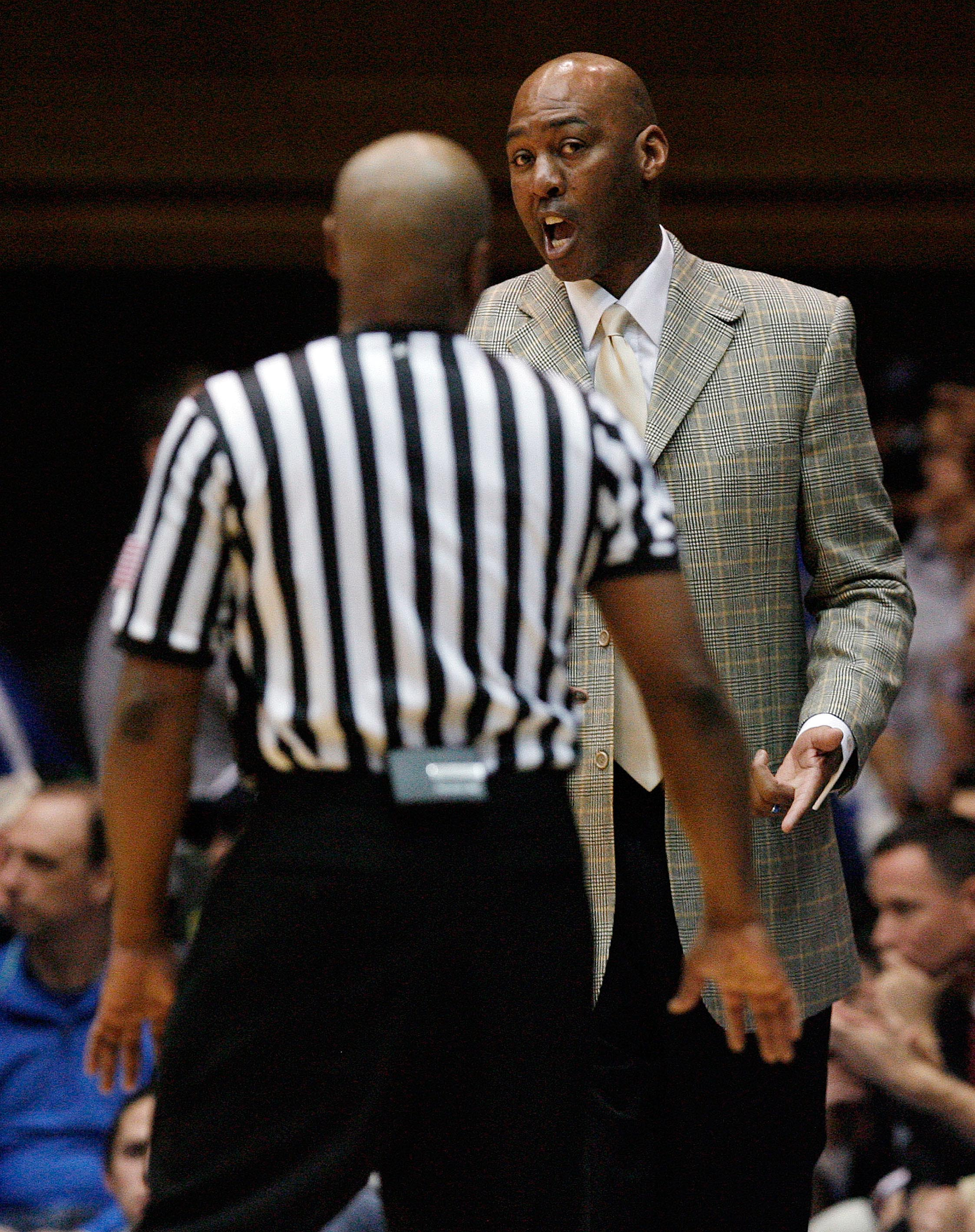 Danny Manning giving this ref a last warning before he delivers a sincere butt whooping.