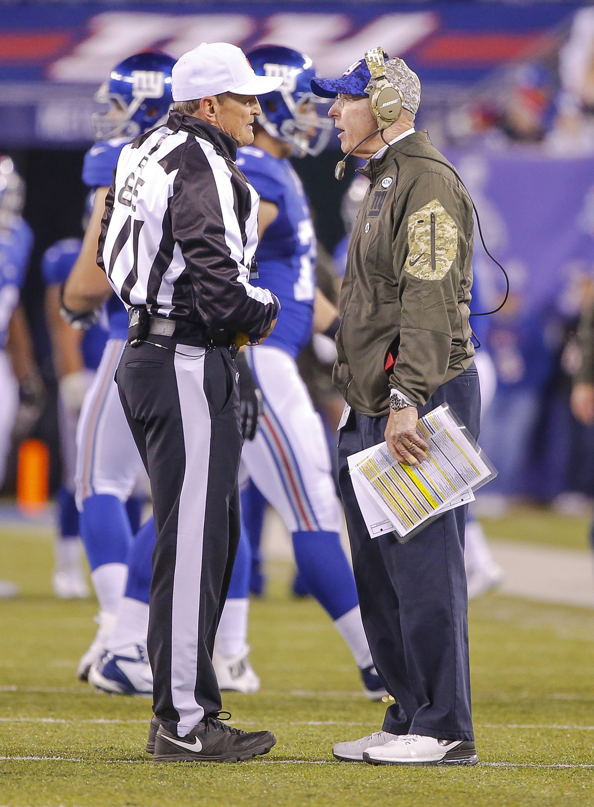 Tom Coughlin talks to referee Ed Hochuli during the second quarter