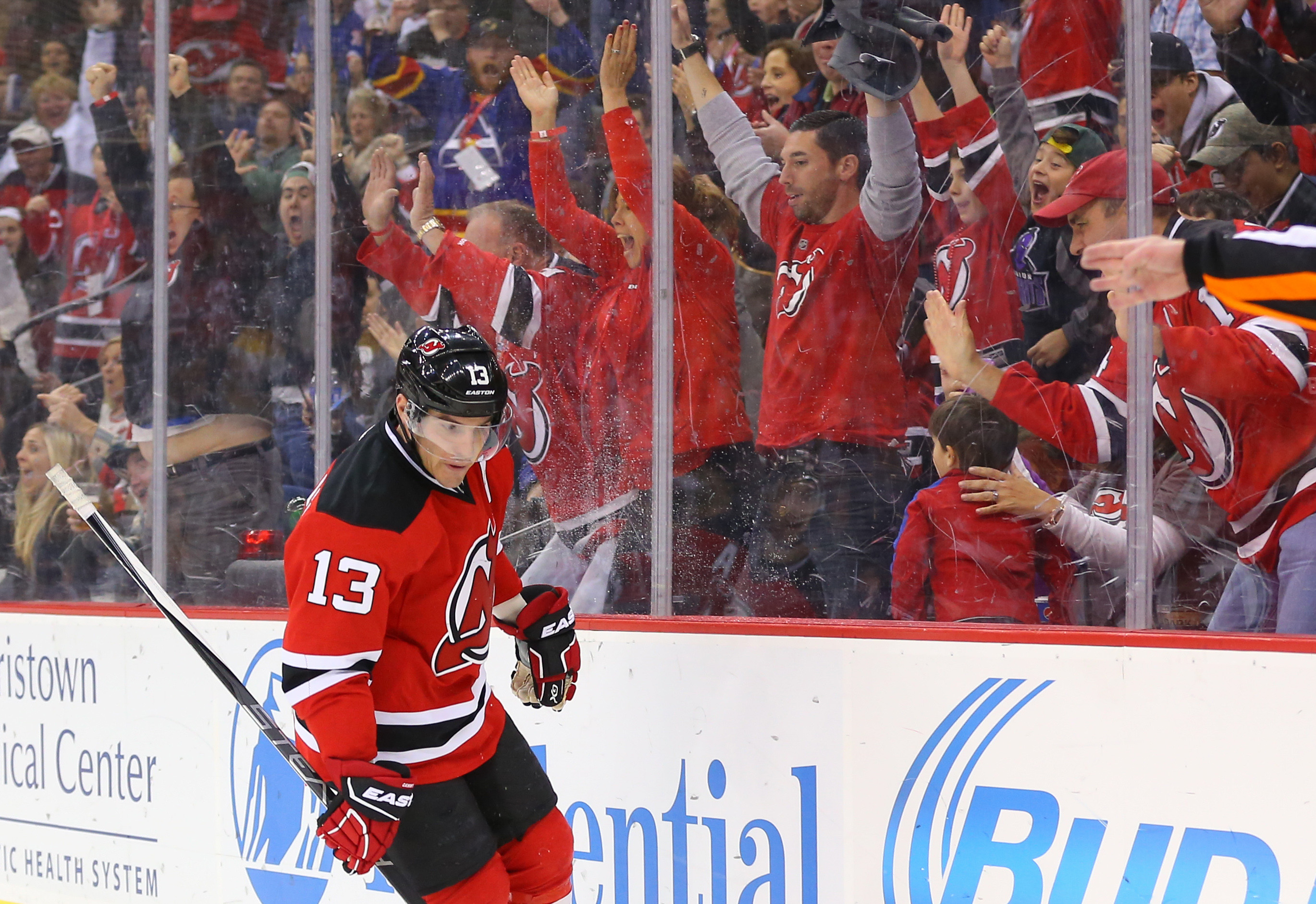 A lot of these people paid quite a lot of money to sit against the glass this season and go wild when a Devil (Mike Cammalleri here) scores a goal.