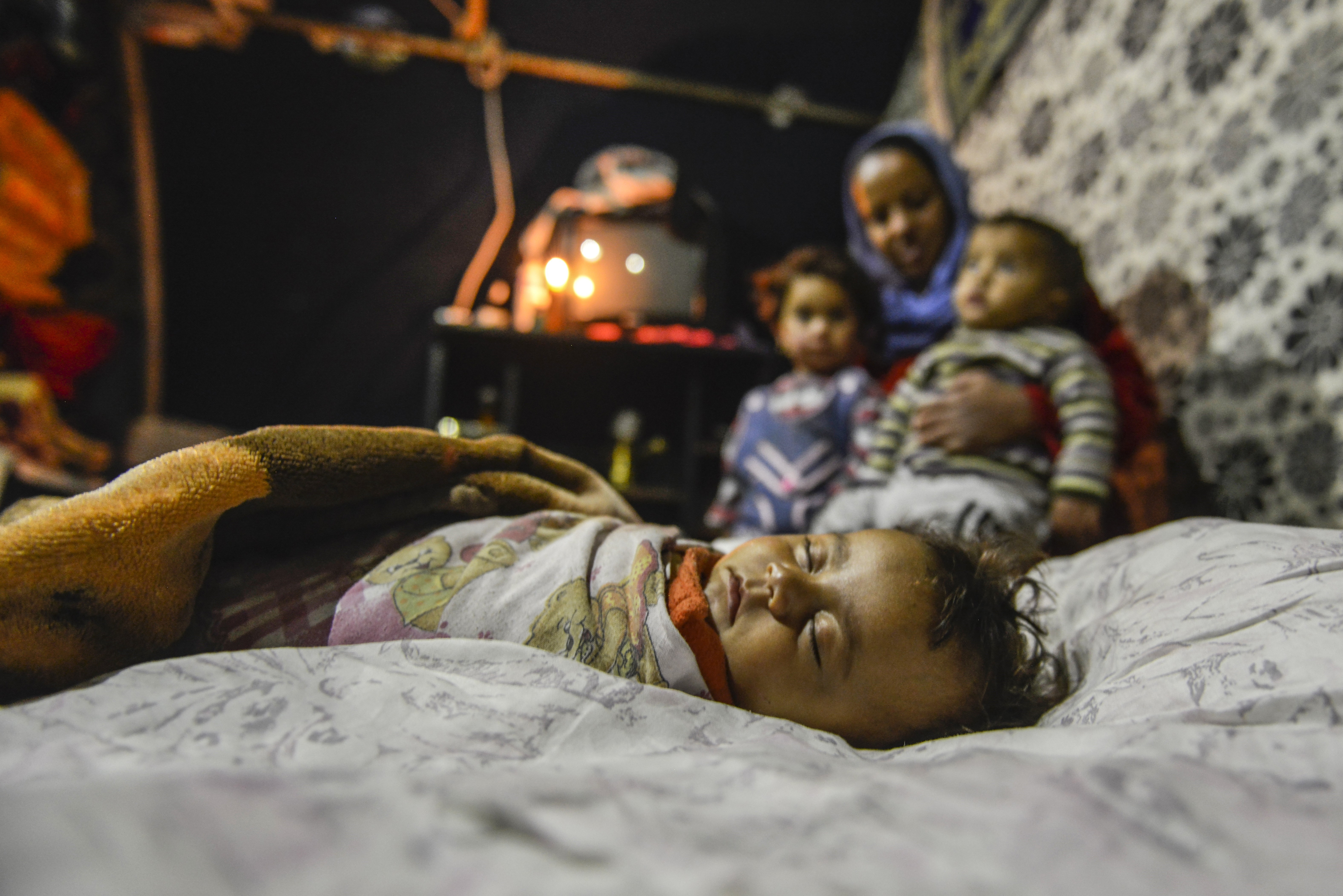 A Syrian refugee baby, who fled the civil war in his country, sleeps in his family's tent in Van, Turkey, on November 16, 2015.