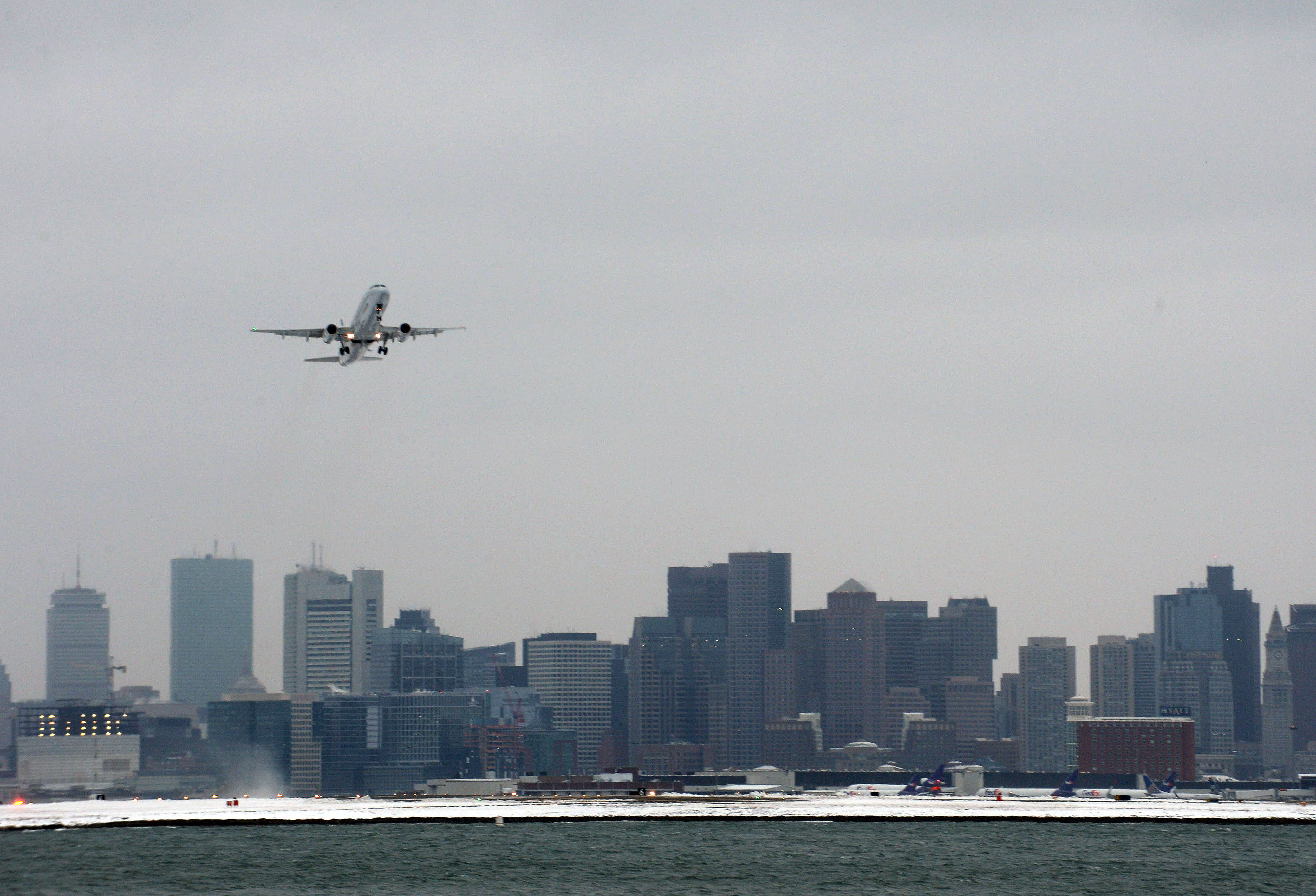 A flight takes off from Logan Airport in January 2015.
