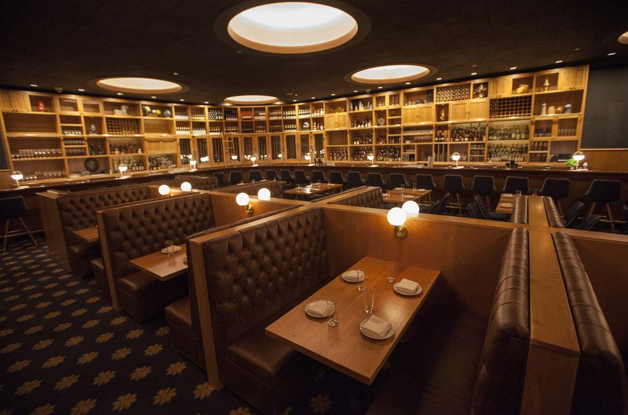 A low-lit dining room with sturdy wooden booths.