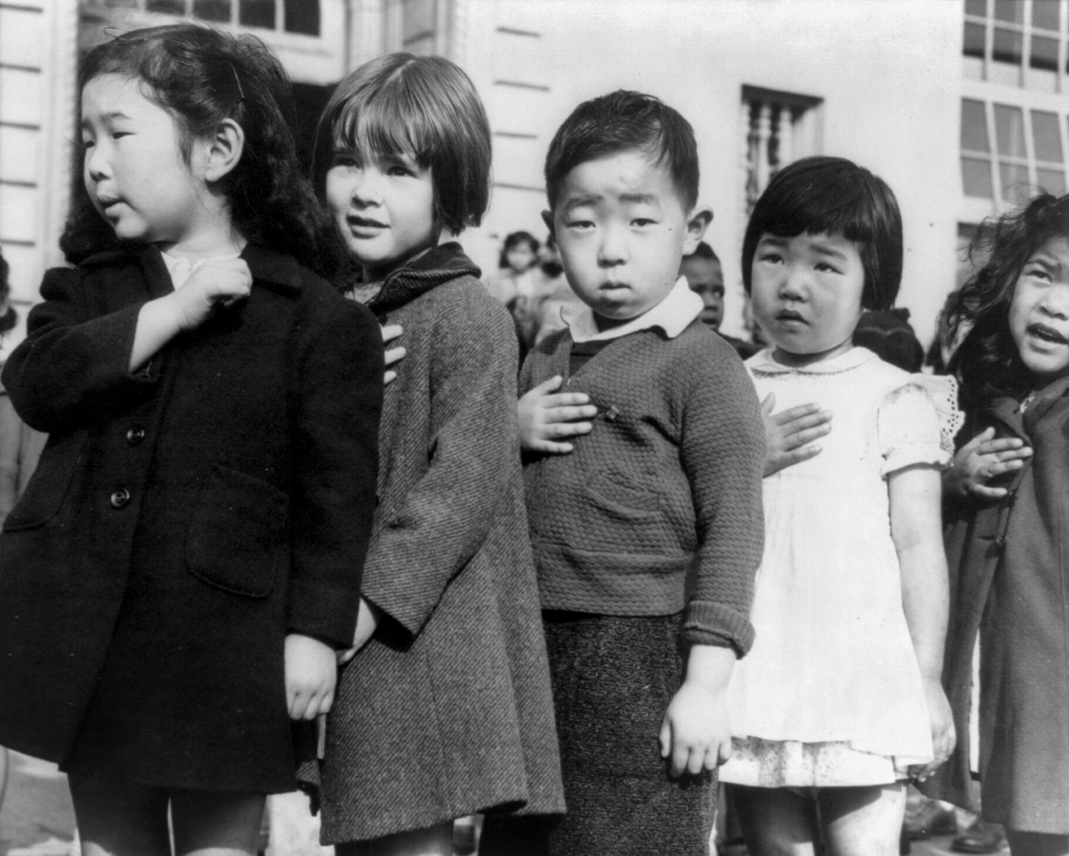 Japanese children standing for the Pledge of Allegiance before internment in 1942.