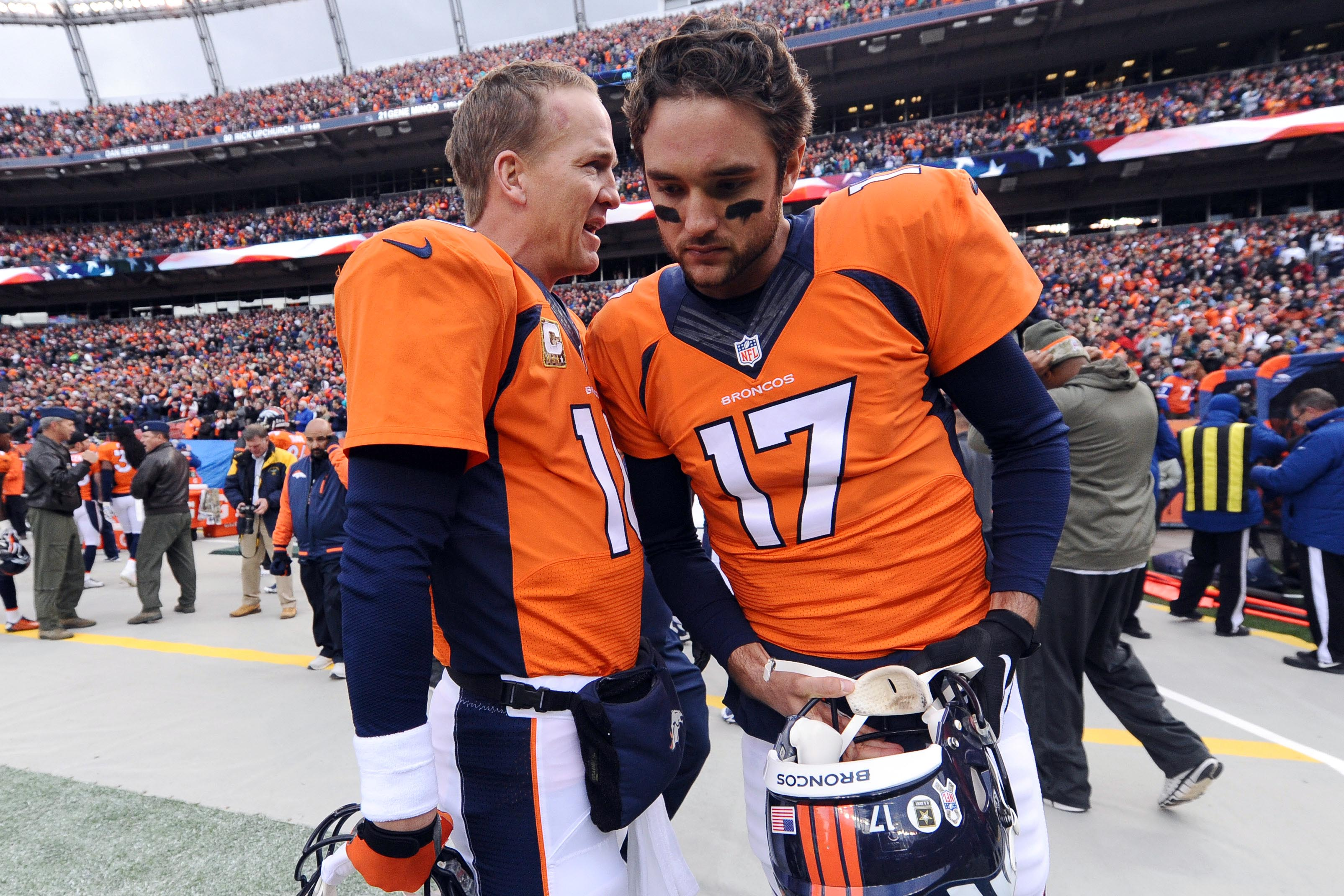 Peyton Manning, left, and Brock Osweiler