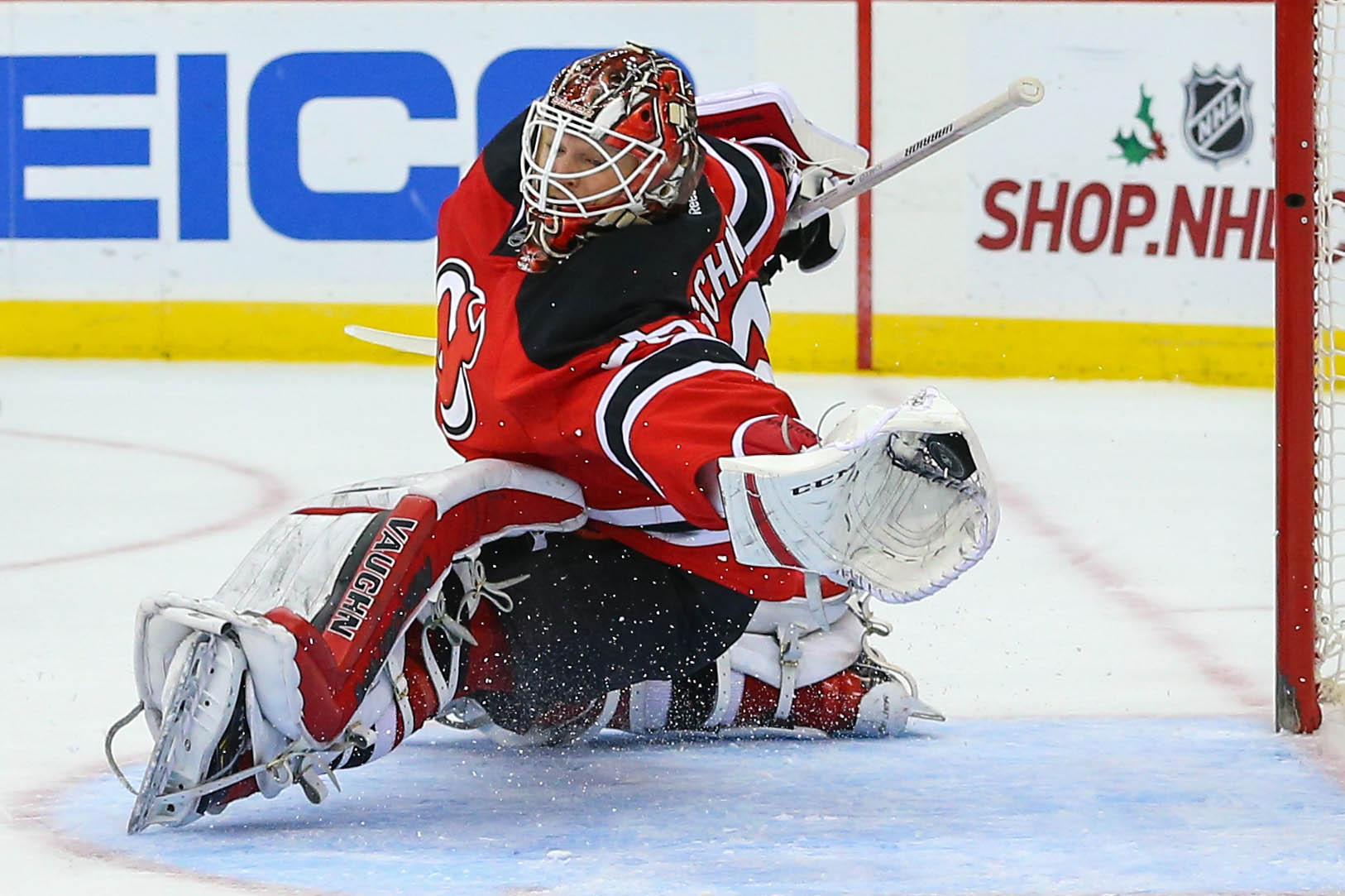 Cory Schneider: pictured making one of the 274 saves he made in November 2015.