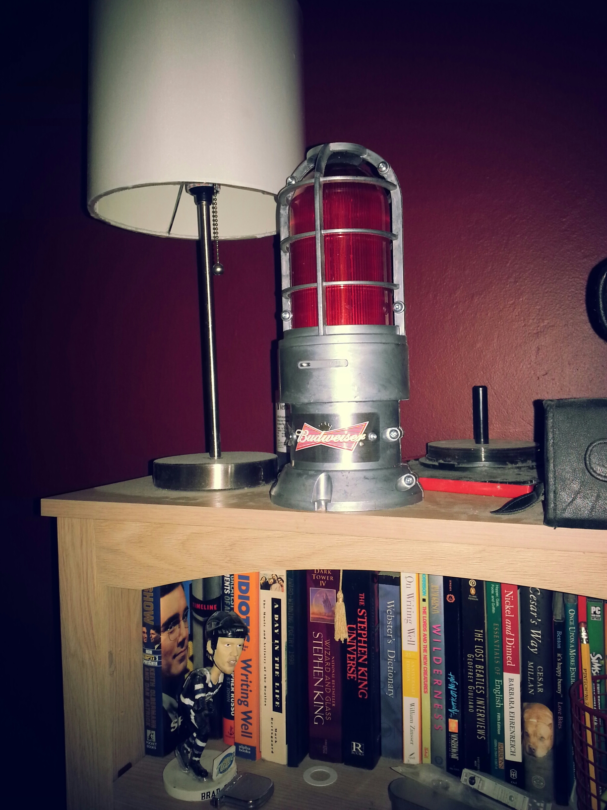 The Budweiser Red Light sitting on a bookshelf. Where else was I supposed to put it?