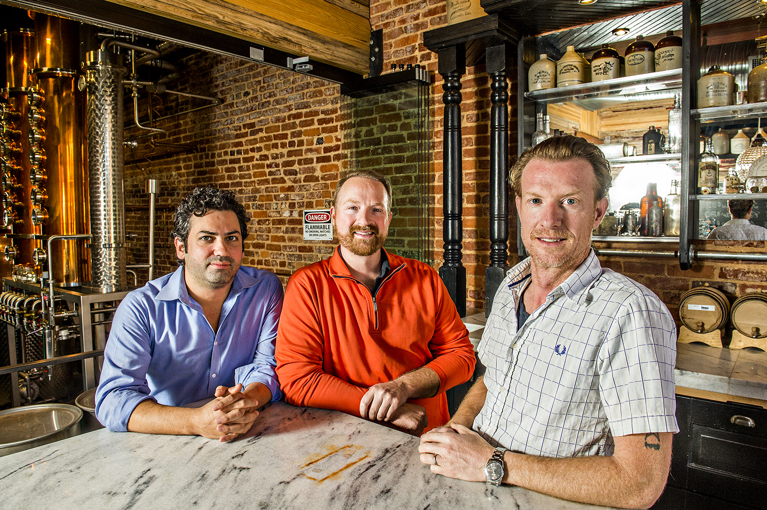 Gabe Pilato (left), Craig Moore (center), and his brother Jeff are the brains, brawn, and faces behind Old 4th Distillery.