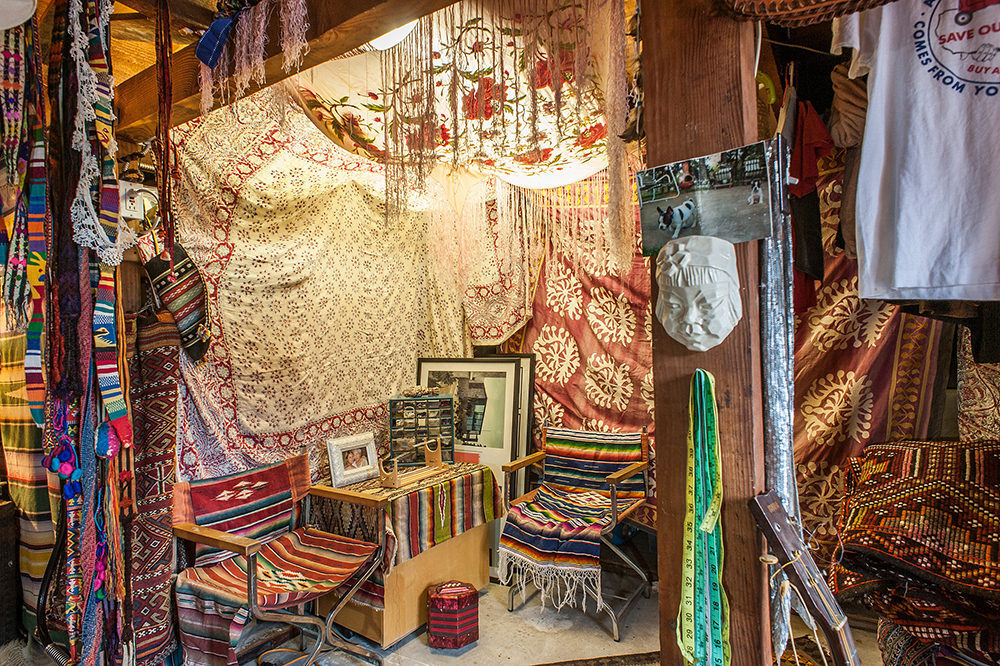 """The detached studio and office area located under the guest house functions as a """"creative studio"""" for both Vanessa's store and Charlie's hat-making."""