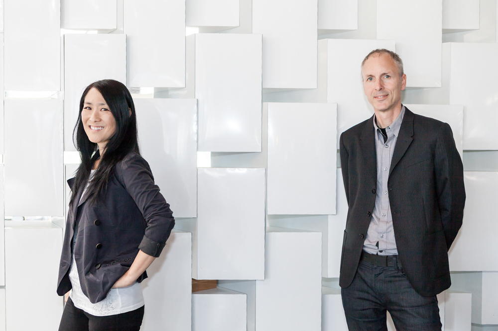 """Lisa Iwamoto and Craig Scott in their studio. Photo by <a href=""""http://www.patriciachangphotography.com/"""">Patricia Chang</a>."""