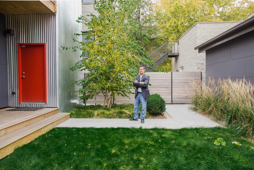 """Jeffrey Sommers in front of his <a href=""""http://www.squarerootarch.com/projects/606209/c3prefab-v11"""">C3 Prefab v1.1</a> in Chicago. Photo by <a href=""""http://debbiecarlos.com/"""">Debbie Carlos</a>."""