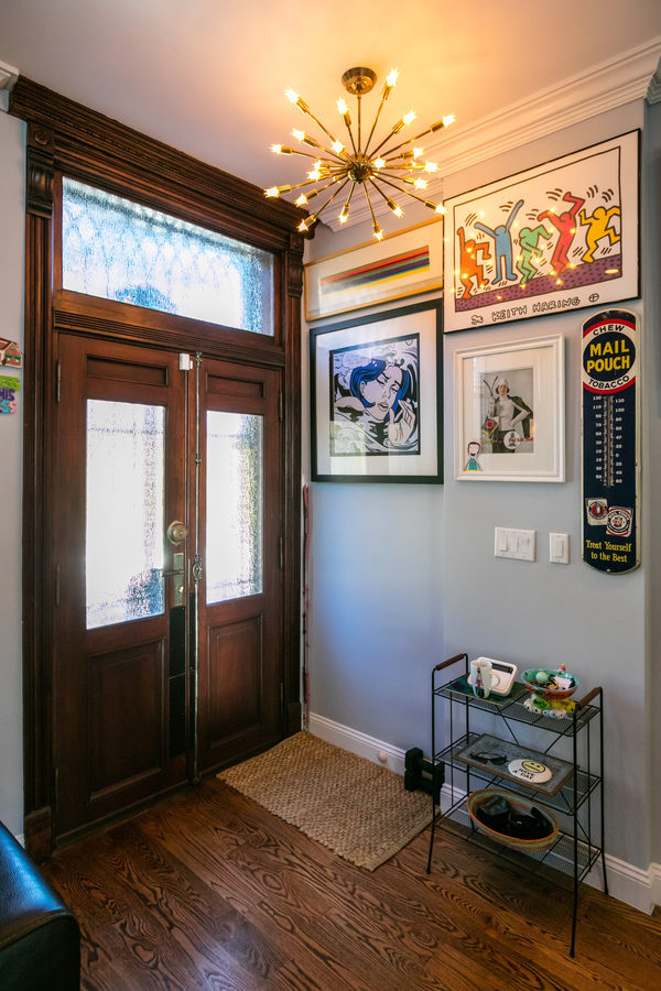 The parlor floor entry opens right into the living area. Haynes says he regrets ripping out the entry vestibule, but with a townhouse that's only 16.5 feet wide, it made the space feel too cramped.