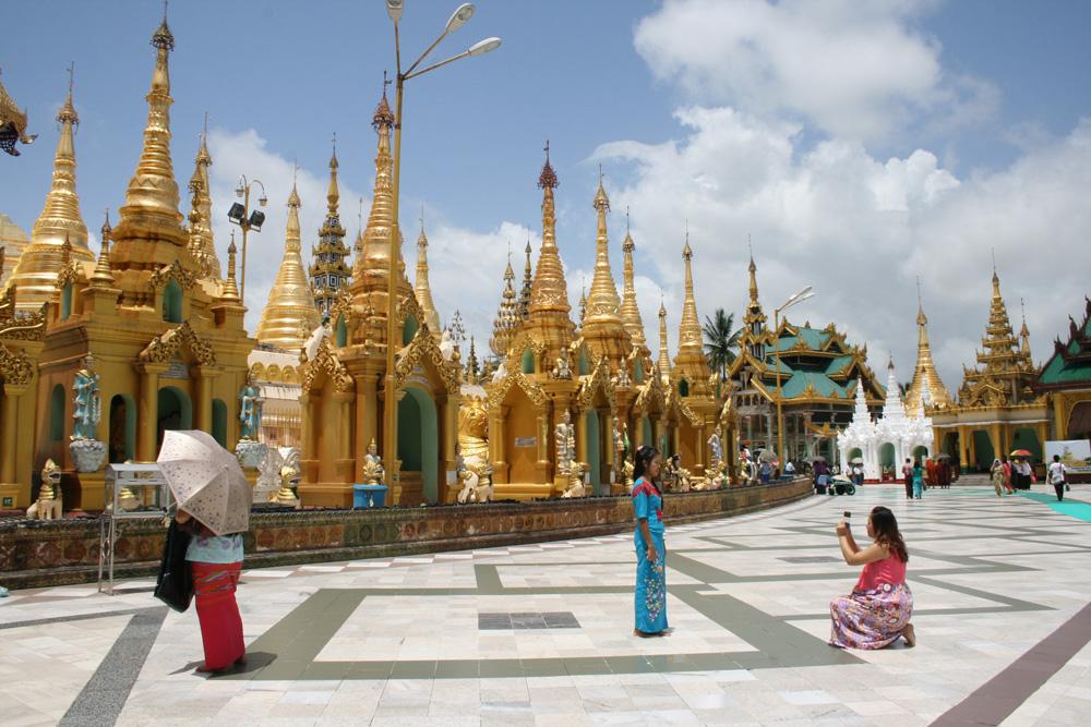 Visitors to the Shwedagon Pagoda grounds in Yangon, Myanmar, snap photos. Photo by Kristi Eaton.