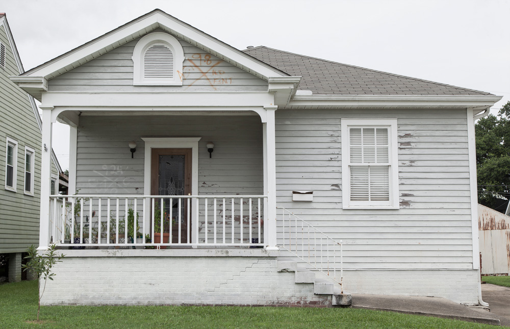 Two sets of FEMA markings on this Lakeview house show separate instances when the house was searched. The markings dated September 8 denote no entry attempt was made during search and rescue, while on September 24 the house was searched inside with