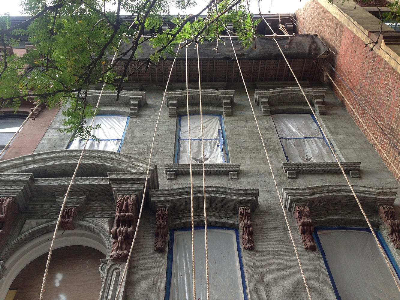 The scratch coat installed on the front facade of the brownstone. Photo by Buck Projects.