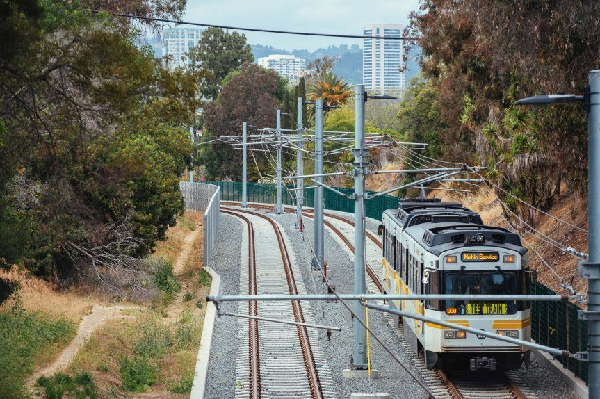 """Westwood in the background as the train heads toward Overland Avenue. Photo by Steve Hymon / <a href=""""http://thesource.metro.net/2015/05/08/photos-signal-testing-in-west-l-a-for-expo-line-2/"""">The Source</a>."""