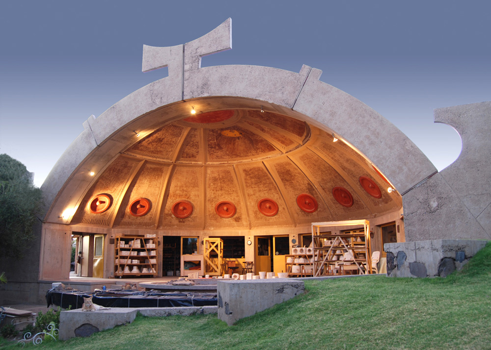 The outside shell of Arcosanti's ceramics apse was shaped over a form carved of fine silt. The apse faces south, allowing for shading in the summer from the sun straight overhead. In the winter months the sun is at a low angle, warming the interior