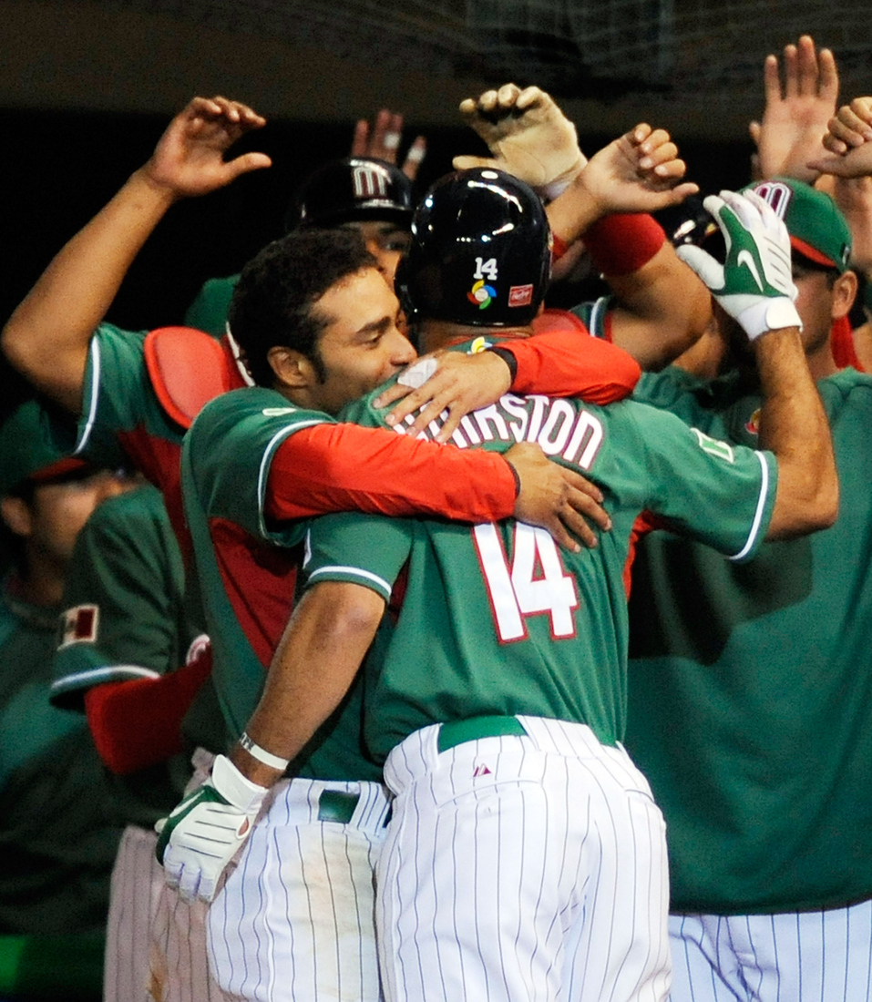 The brothers Hairston celebrate a home run for Team Mexico during the 2009 World Baseball Classic.