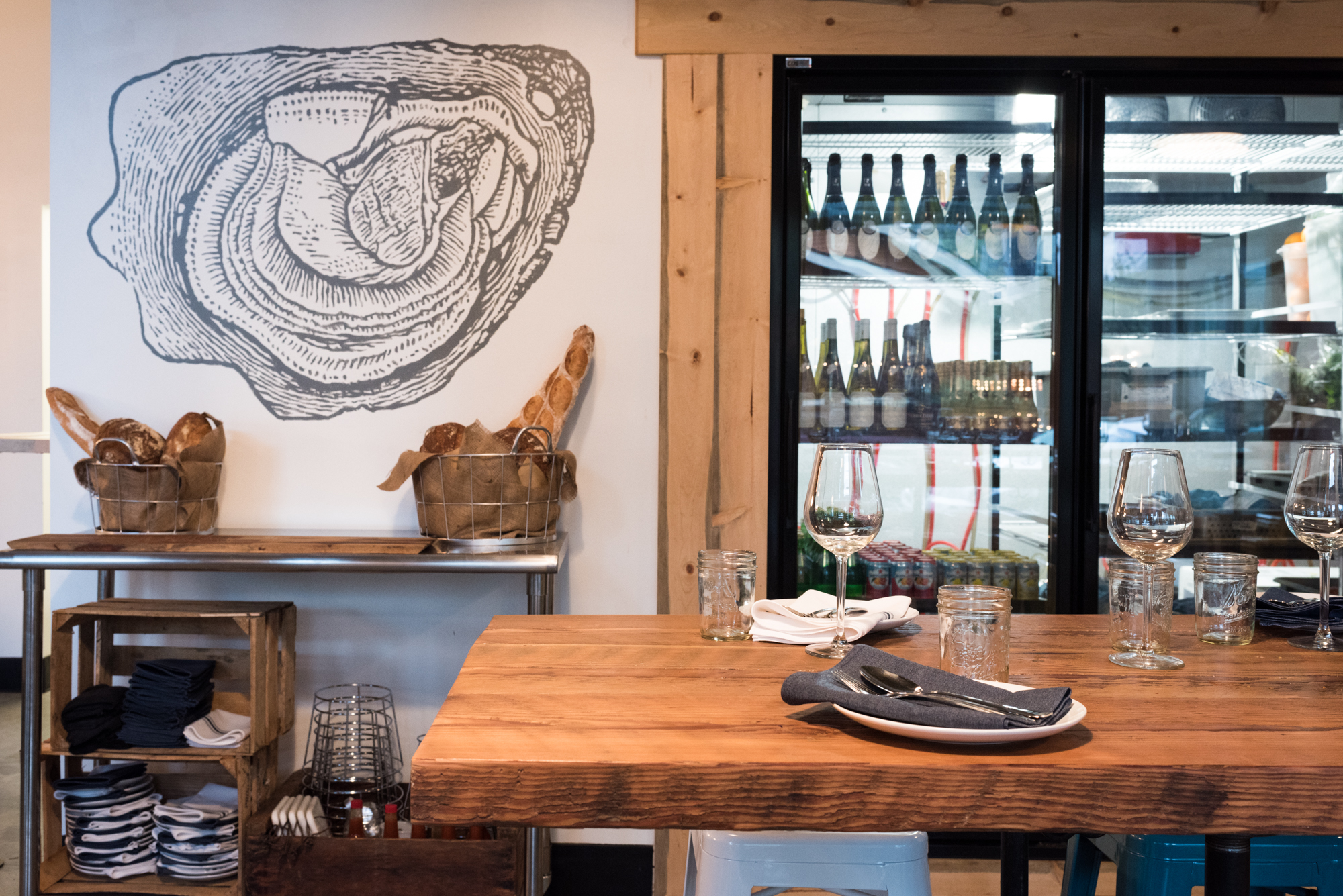 A picture of the interior of Olympia Oyster Bar, with its oyster mural and wine case