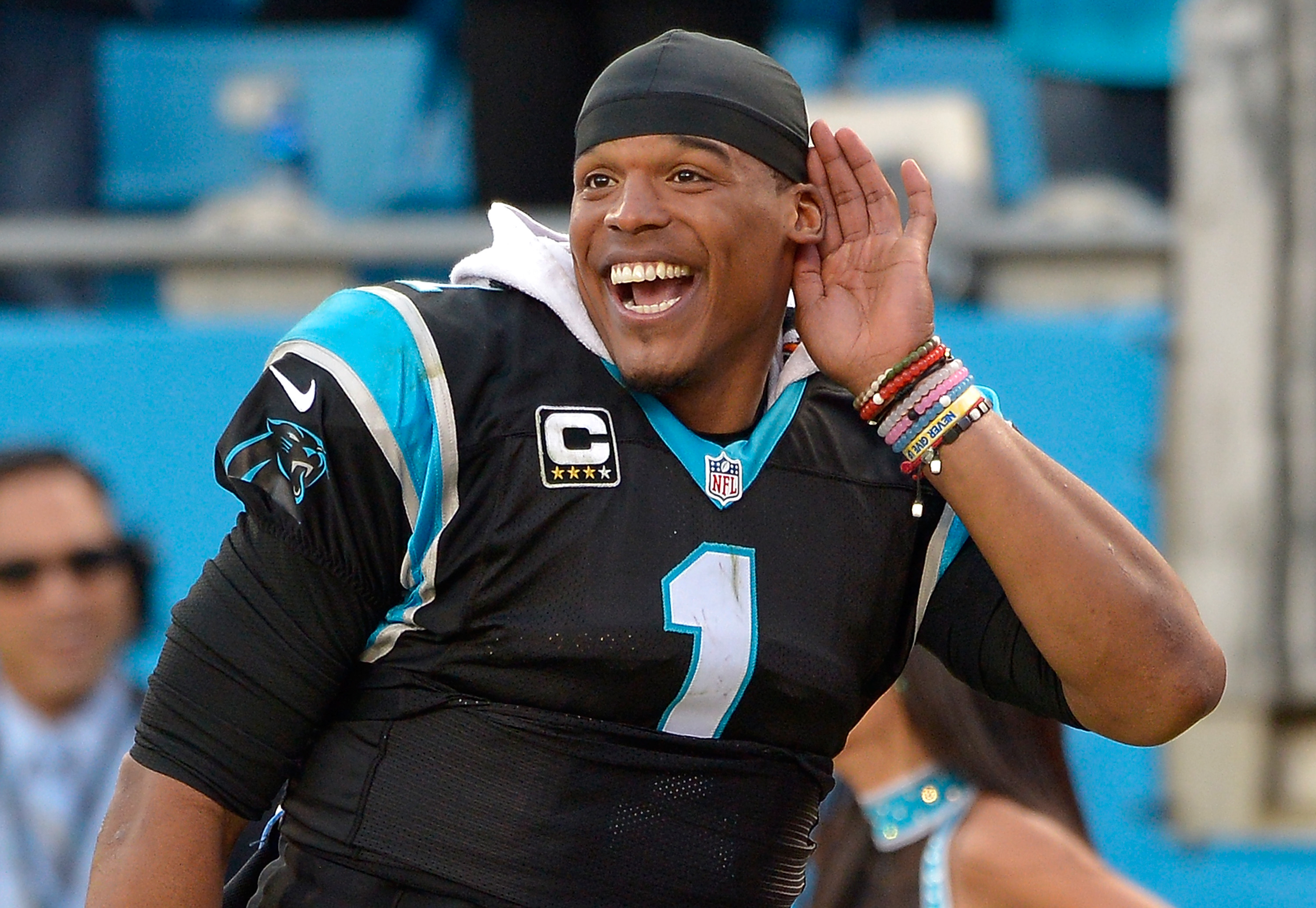 Cam Newton listening to the crowd cheer