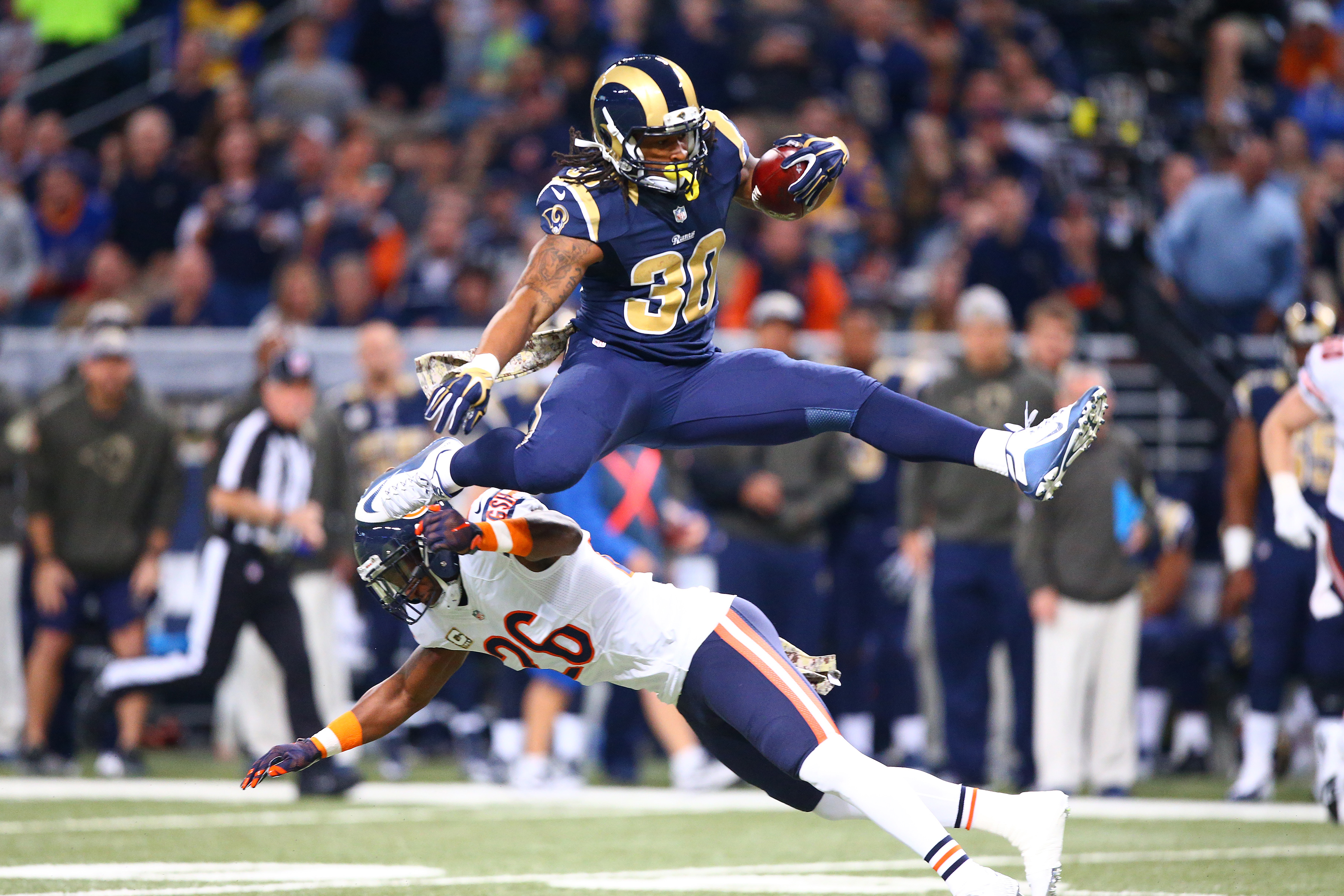 Todd Gurley leaps over former Giants safety Antrel Rolle.