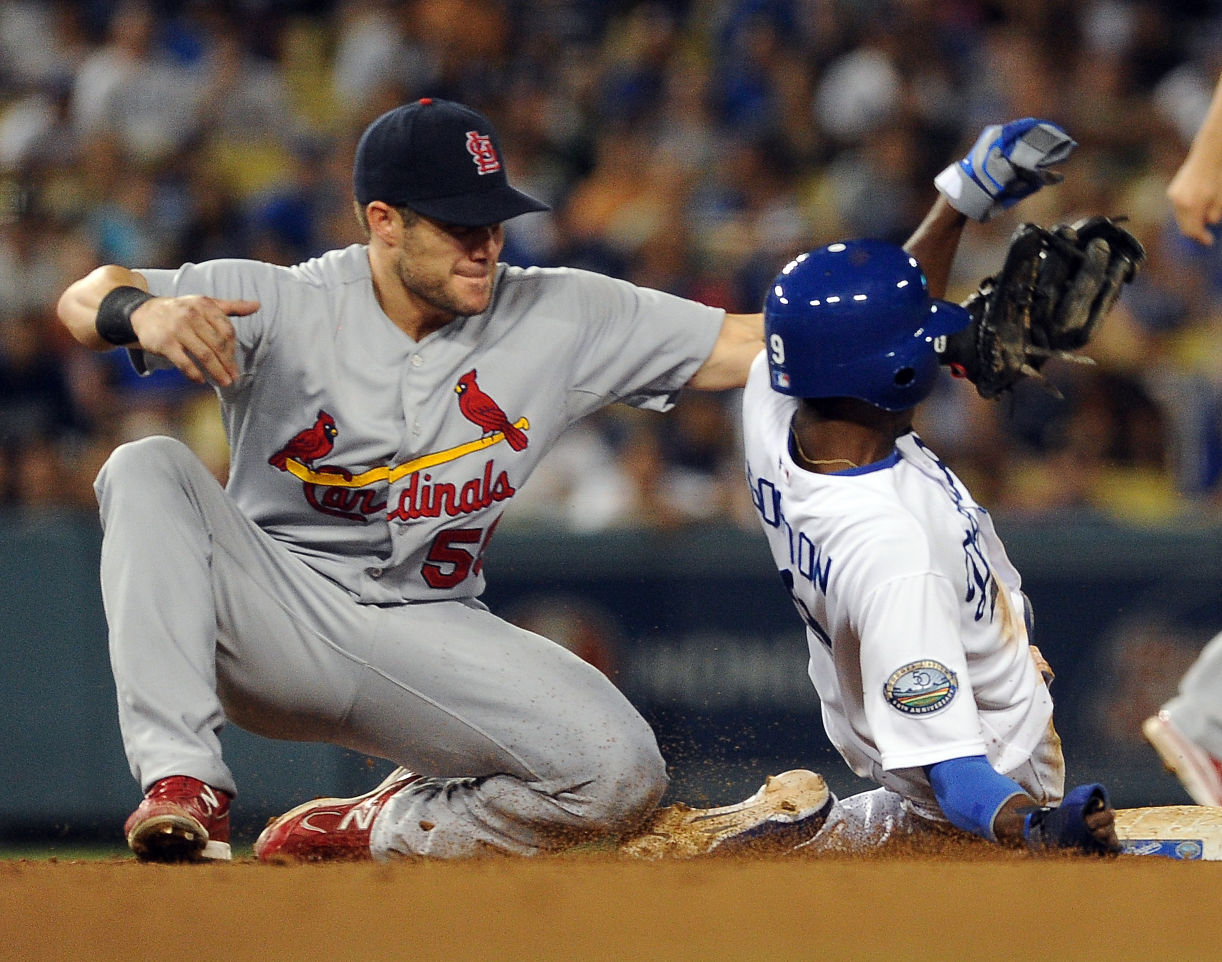 Skip Schumaker gets up close and personal with his new teammate.