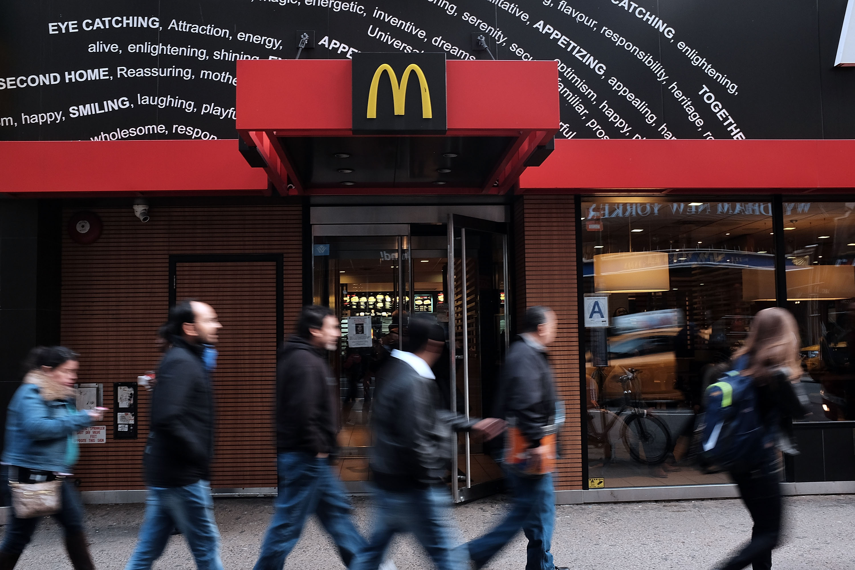 Restaurants like McDonald's will have to start raising minimum wage next year.