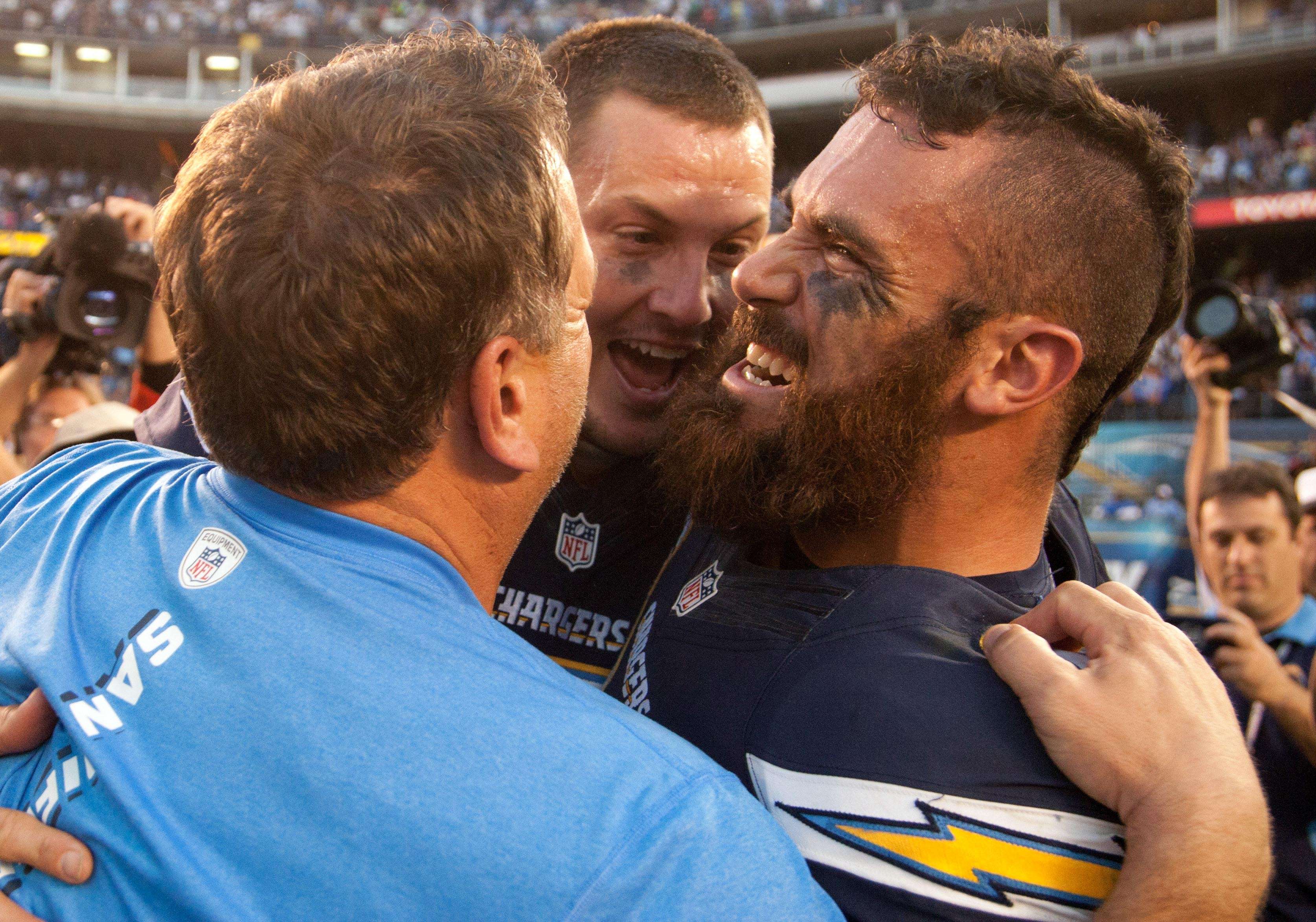Philip Rivers and Eric Weddle following a 27-24 OT win against the Chiefs on 12/29/13