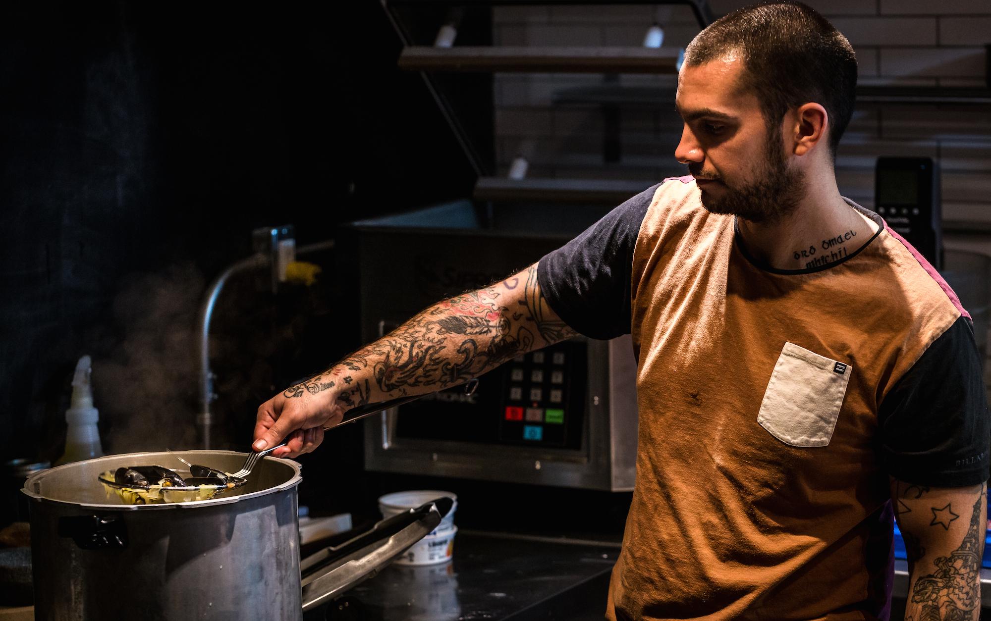 A member of Antonin Mousseau-Rivard's kitchen brigade at work