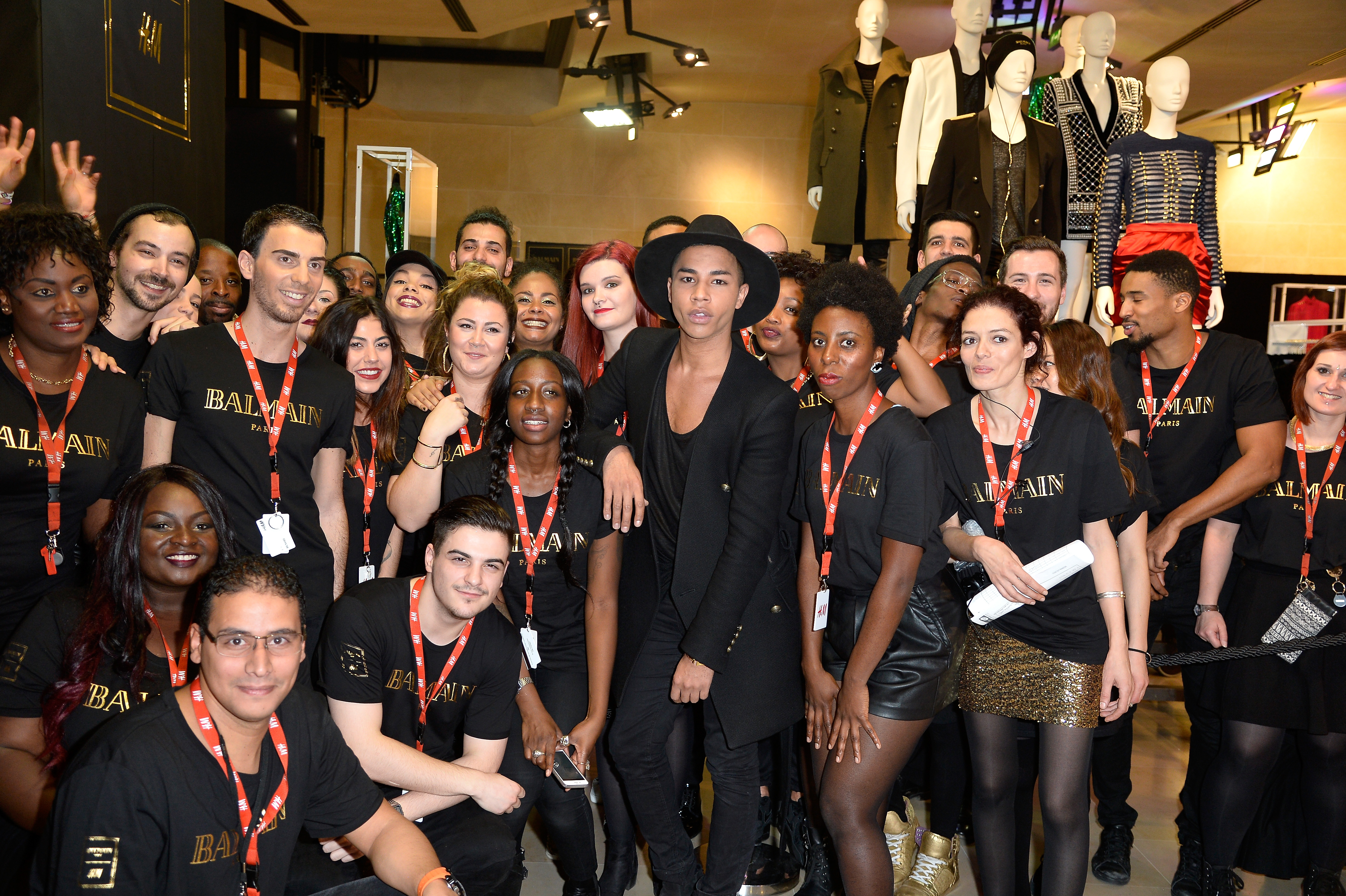 Olivier Rousteing with staff at H&M Champs Elysees