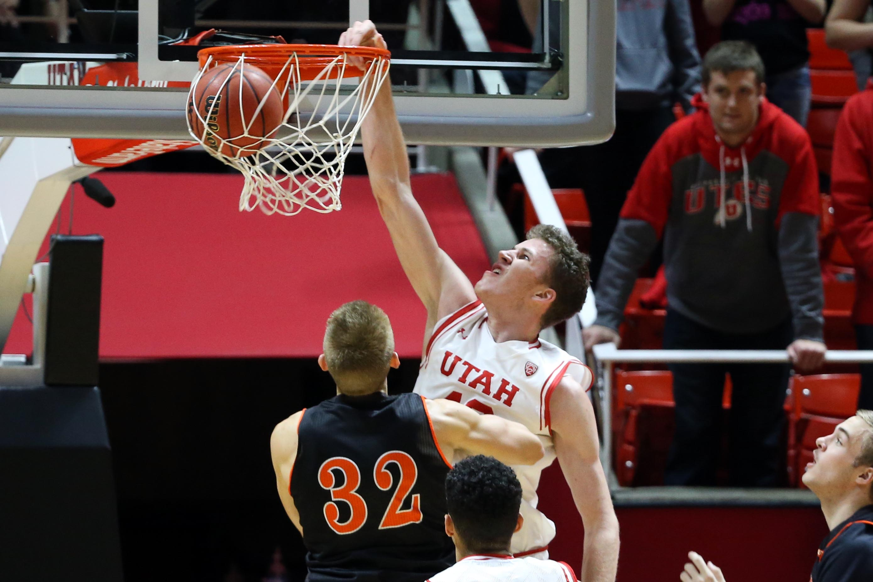 Sophomore center Jakob Poeltl (shown dunking) leads the no. 24 Runnin' Utes with 18 point and 9.7 rebounds per game.