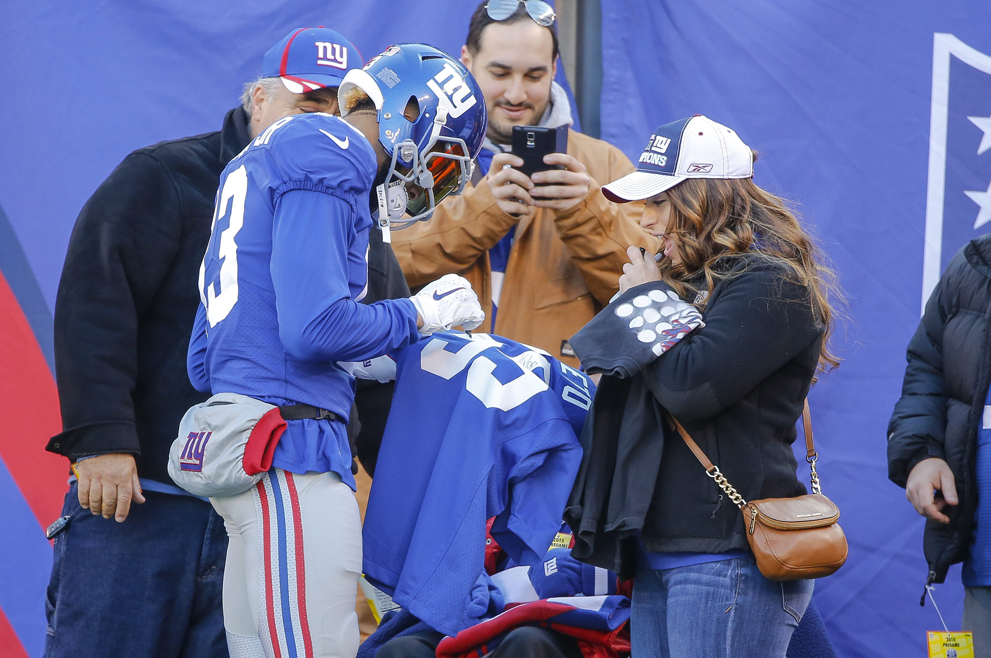 Odell Beckham Jr. signs autographs for fans before Sunday's game