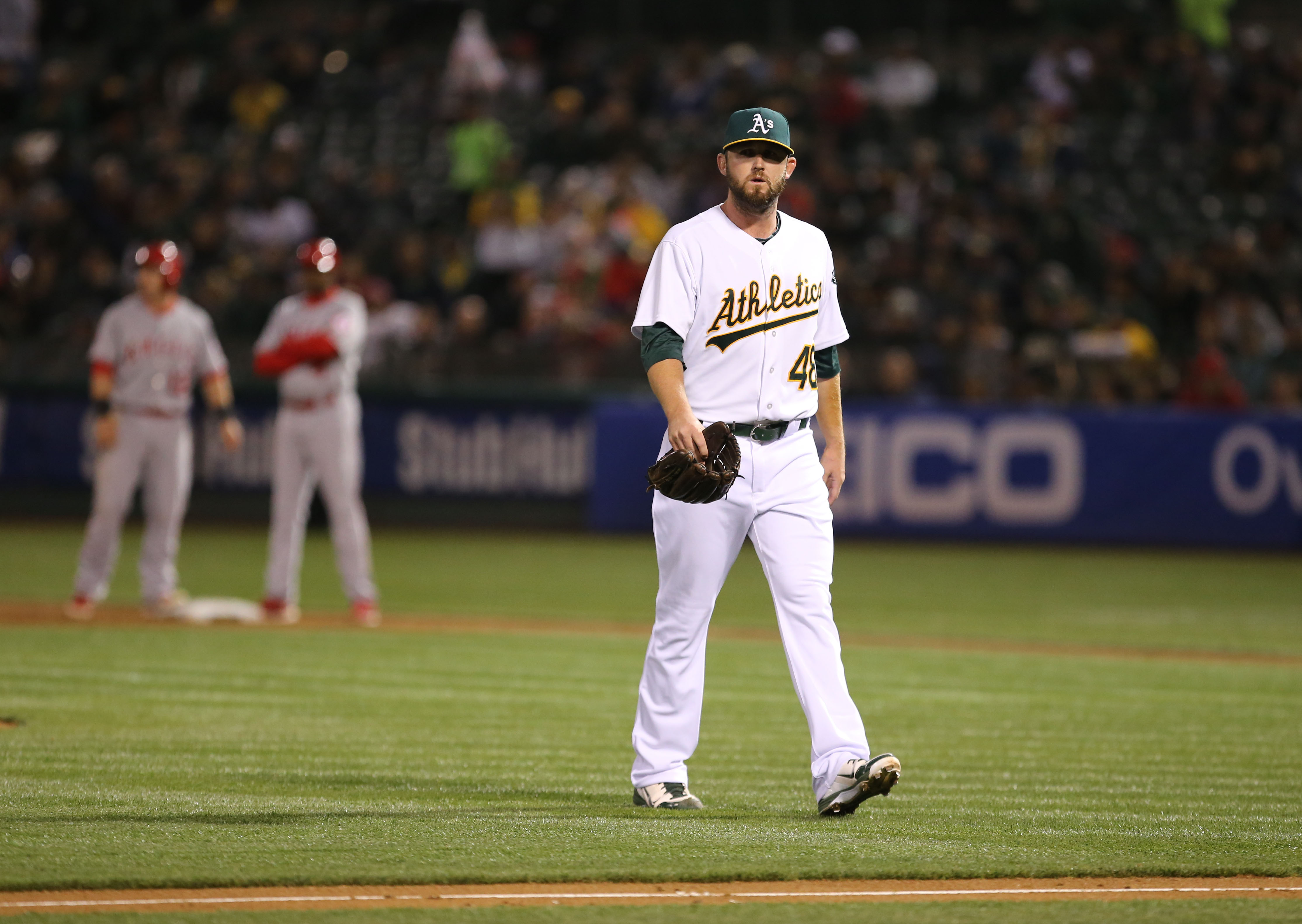 Ryan Cook exits after allowing an RBI single in April.