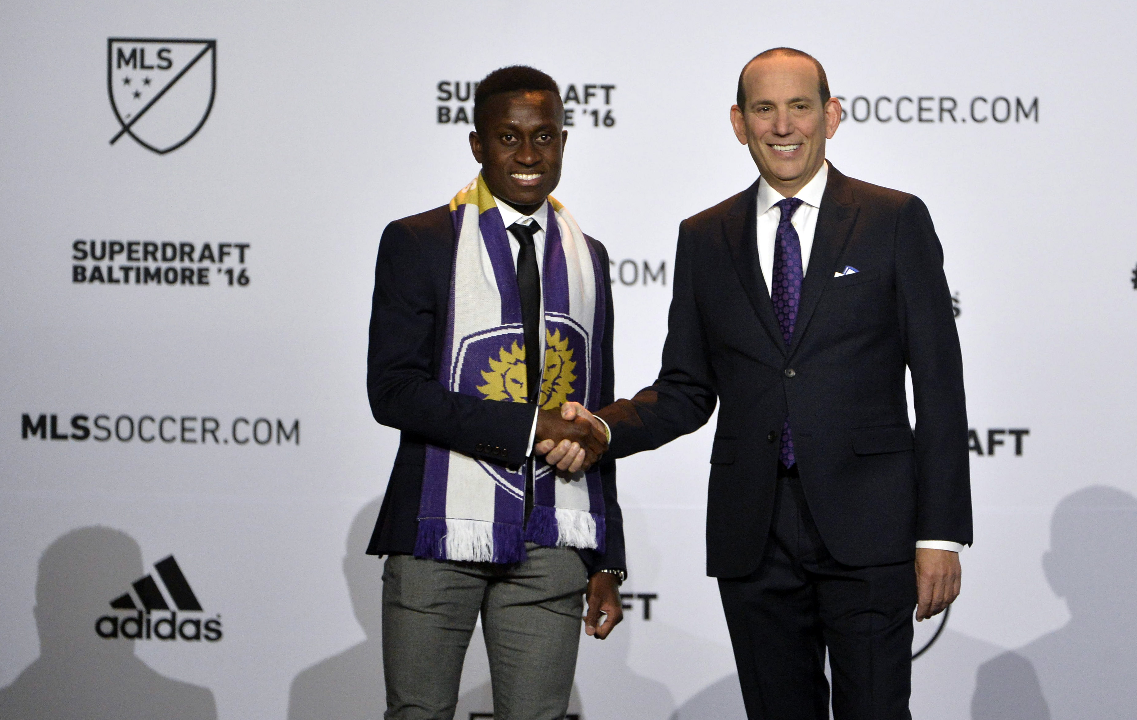 Laryea shakes hands with MLS commissioner Don Garber after being drafted in 2016 MLS SuperDraft.