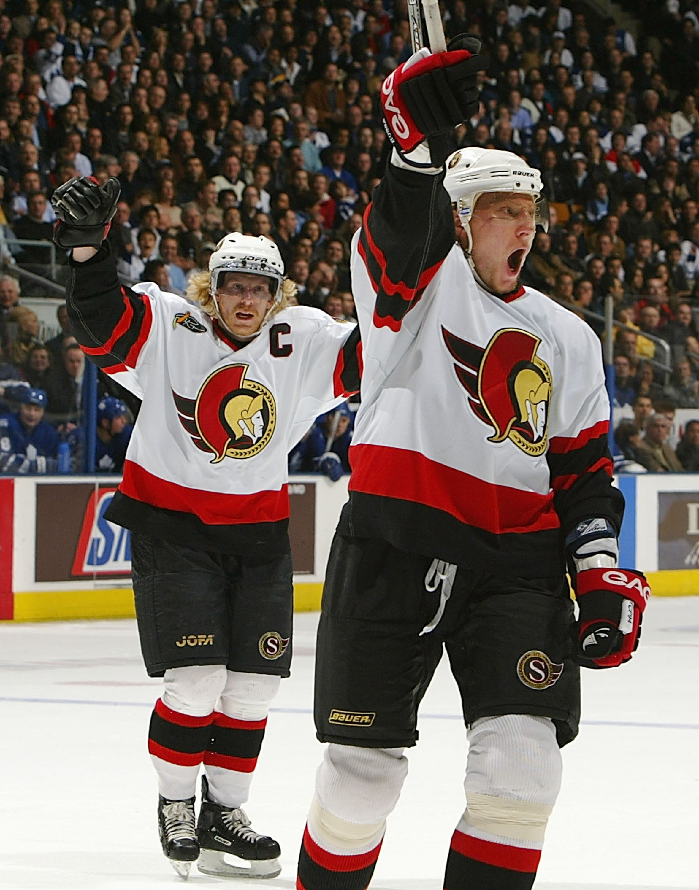 I don't know what I like more, those beautiful jerseys or Hossa's opera attempt