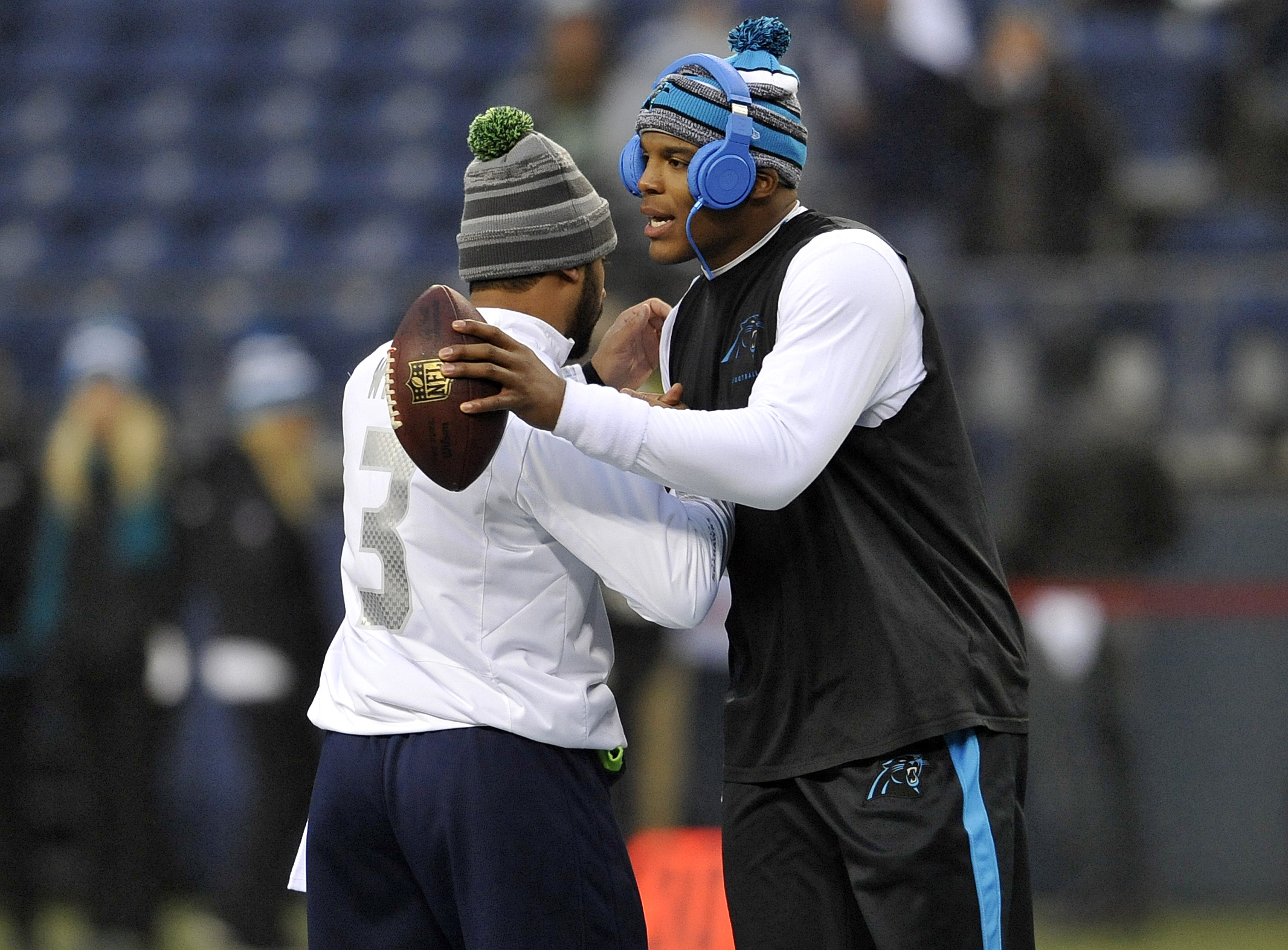 Russell Wilson and Cam Newton showing a little pre-game man love last year.