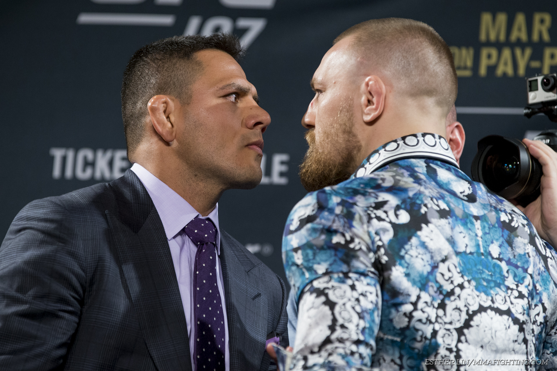 Rafael dos Anjos and Conor McGregor square off at UFC 197 press conference.