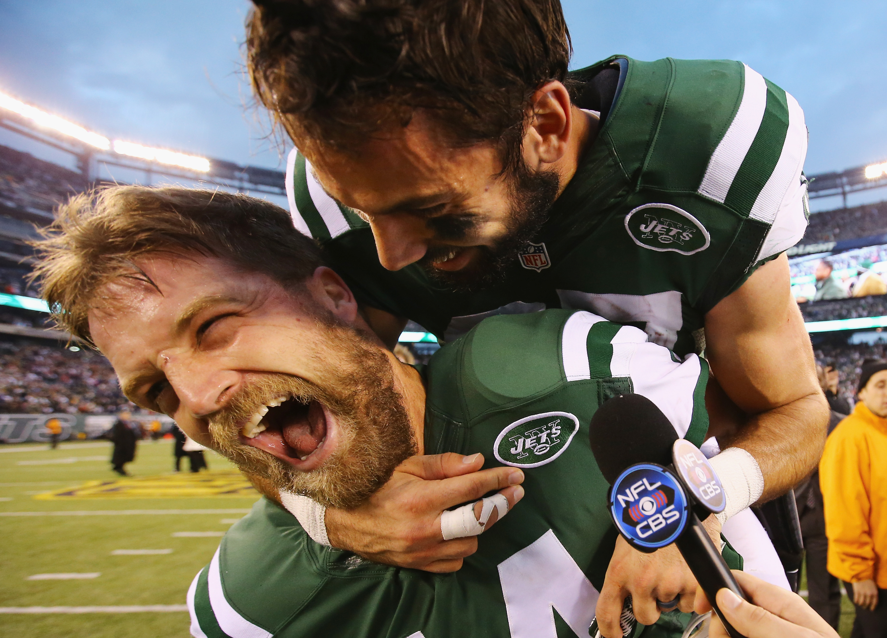 Ryan Fitzpatric, bottom, gets some man love from Eric Decker after the Jets beat the Patriots in Week 16