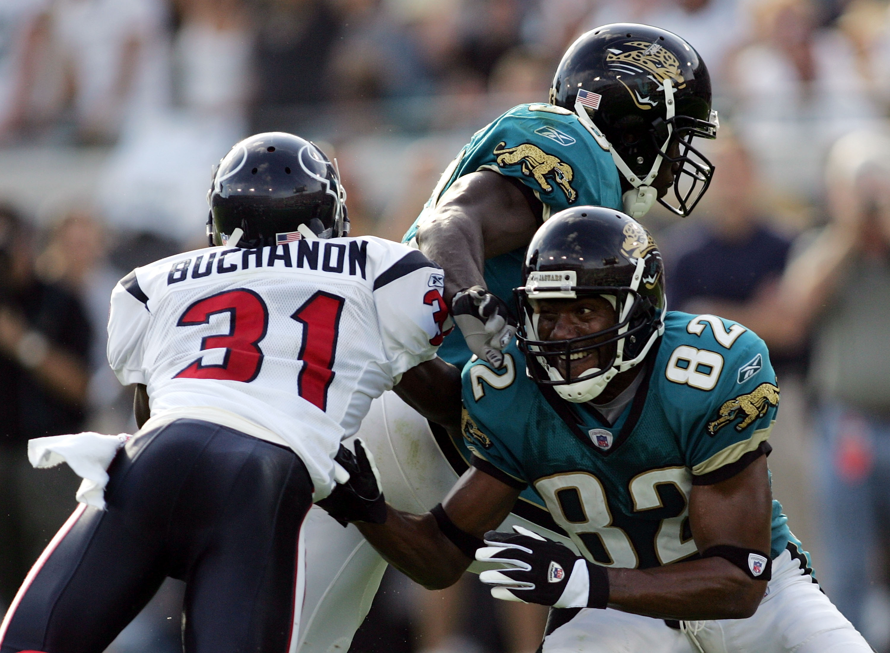 A picture of Phillip Buchanon actually attempting a tackle is basically the NFL version of a unicorn.
