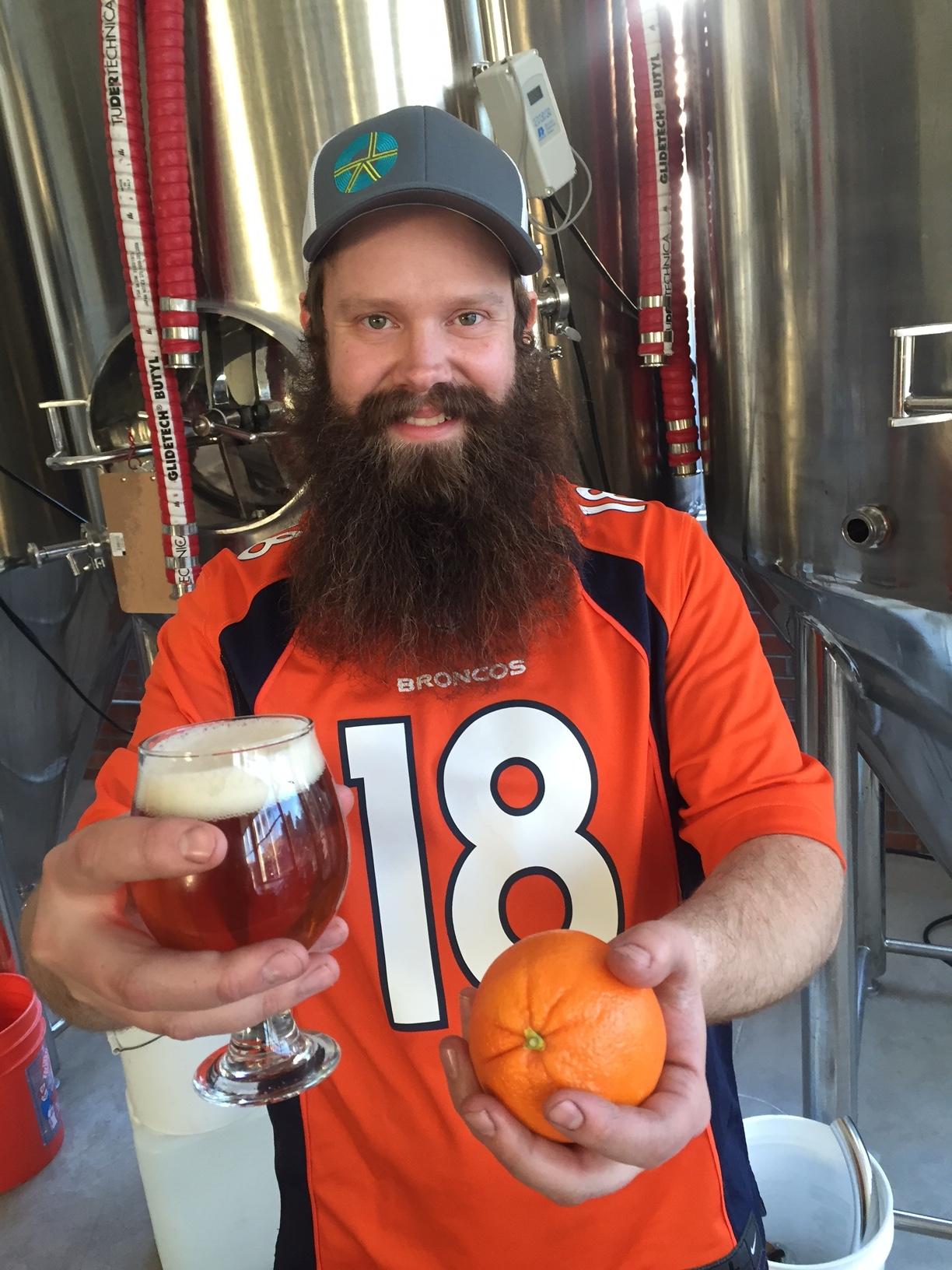 Spangalang brewer Austin Wiley preparing the orange crushsicle