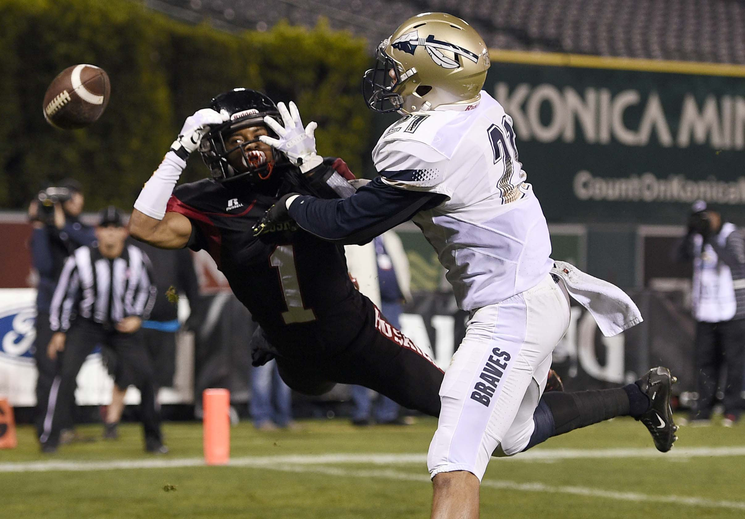 Mykal Tolliver (right) defends a pass while playing for the St. John Bosco Braves