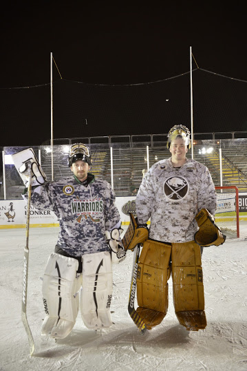 David Qualy, MN Warriors goalie (pictured left) poses for a picture following the Warriors game vs the Buffalo team for HDM2015